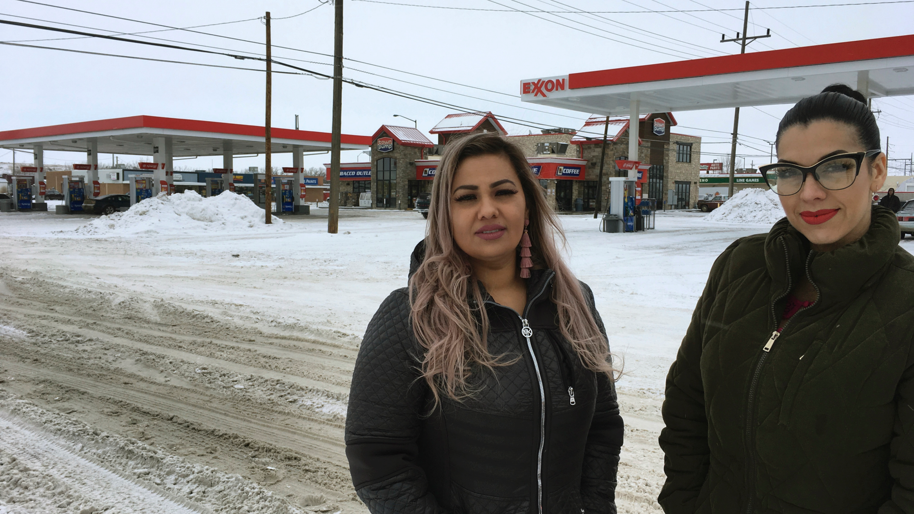 Martha Hernandez, left, and Ana Suda pose in front of a convenience store in Havre, Mont., where they say they were detained by a U.S Border Patrol agent for speaking Spanish last year.