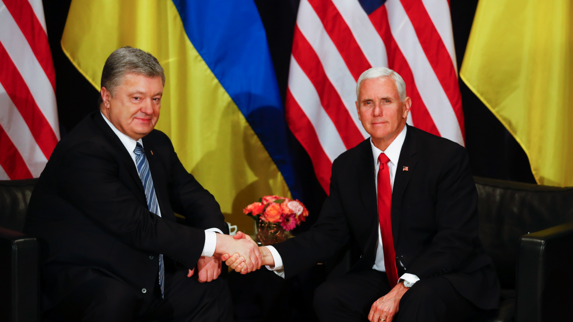 United States Vice President Mike Pence, right, and Ukrainian President Petro Poroshenko, left, shake hands during a bilateral meeting at the Munich Security Conference in Munich, Germany, Saturday, Feb. 16, 2019. (AP Photo/Matthias Schrader)