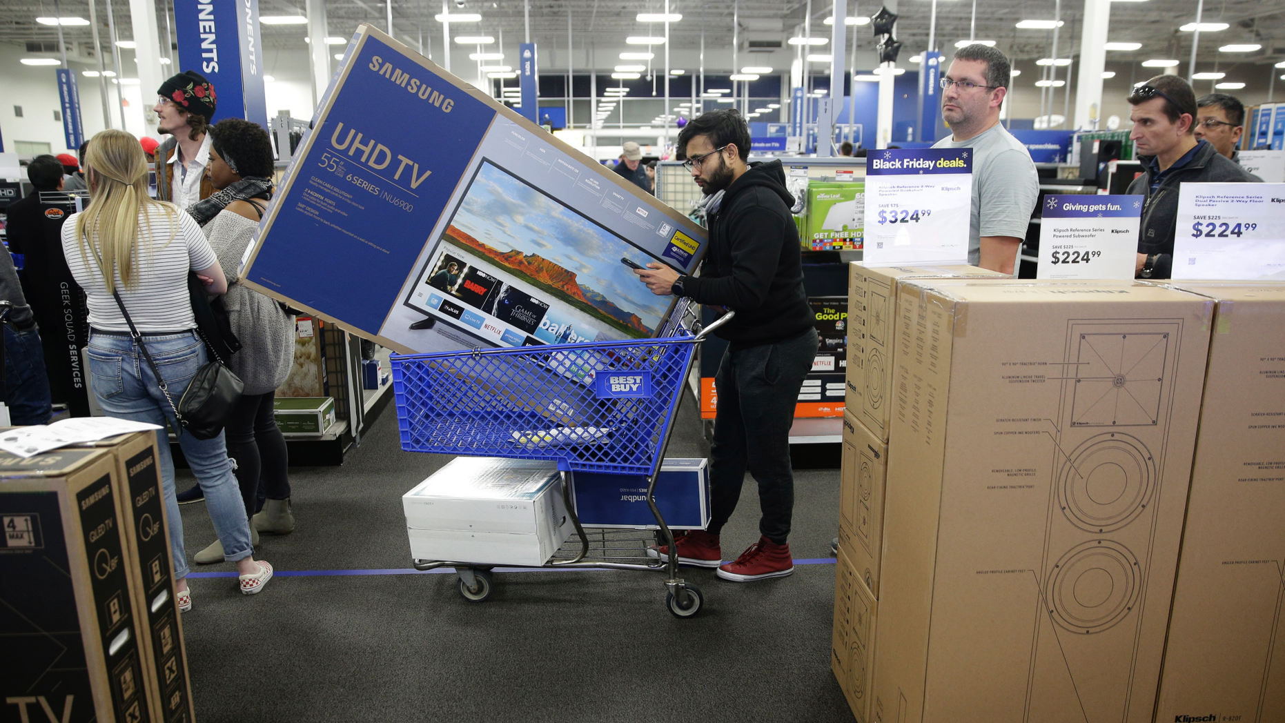 FILE- In these November 22, 2018, photo people are waiting to buy television while buying at an early Black Friday sale at a Best Buy store on Thanksgiving Day in Overland Park, Kan. Best Buy Co., Inc reports financial results Wednesday, February 27, 2019. (AP Photo / Charlie Riedel, File)