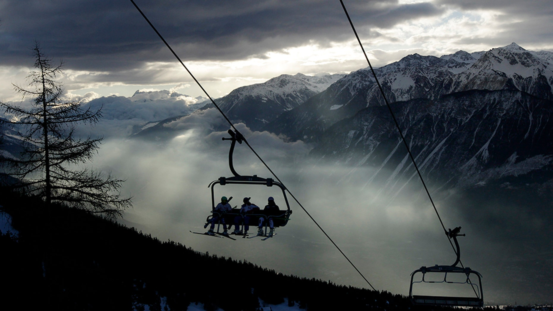 Ski racers sit on the chairlift in the early morning before the first run of the men's Alpine Skiing World Cup Giant Slalom race in Crans-Montana February 26, 2012. REUTERS