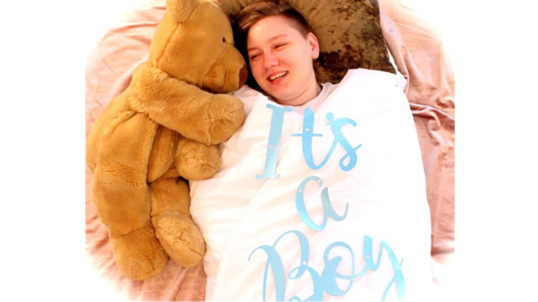 """Heather Lundberg Green coordinated an elaborate photo shoot in honor of her son's transition, where she swaddled him with a white blanket inscribed with """"It's a boy!"""""""