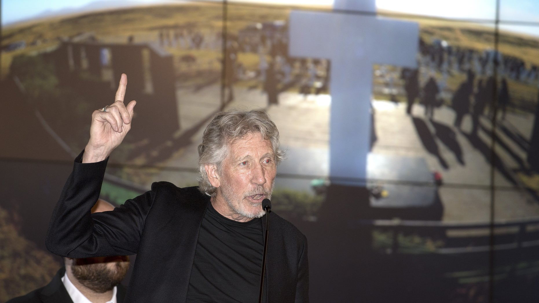 Roger Waters pleaded with Maroon 5, Big Boi and Travis Scott to kneel during Super Bowl Halftime Show performance.