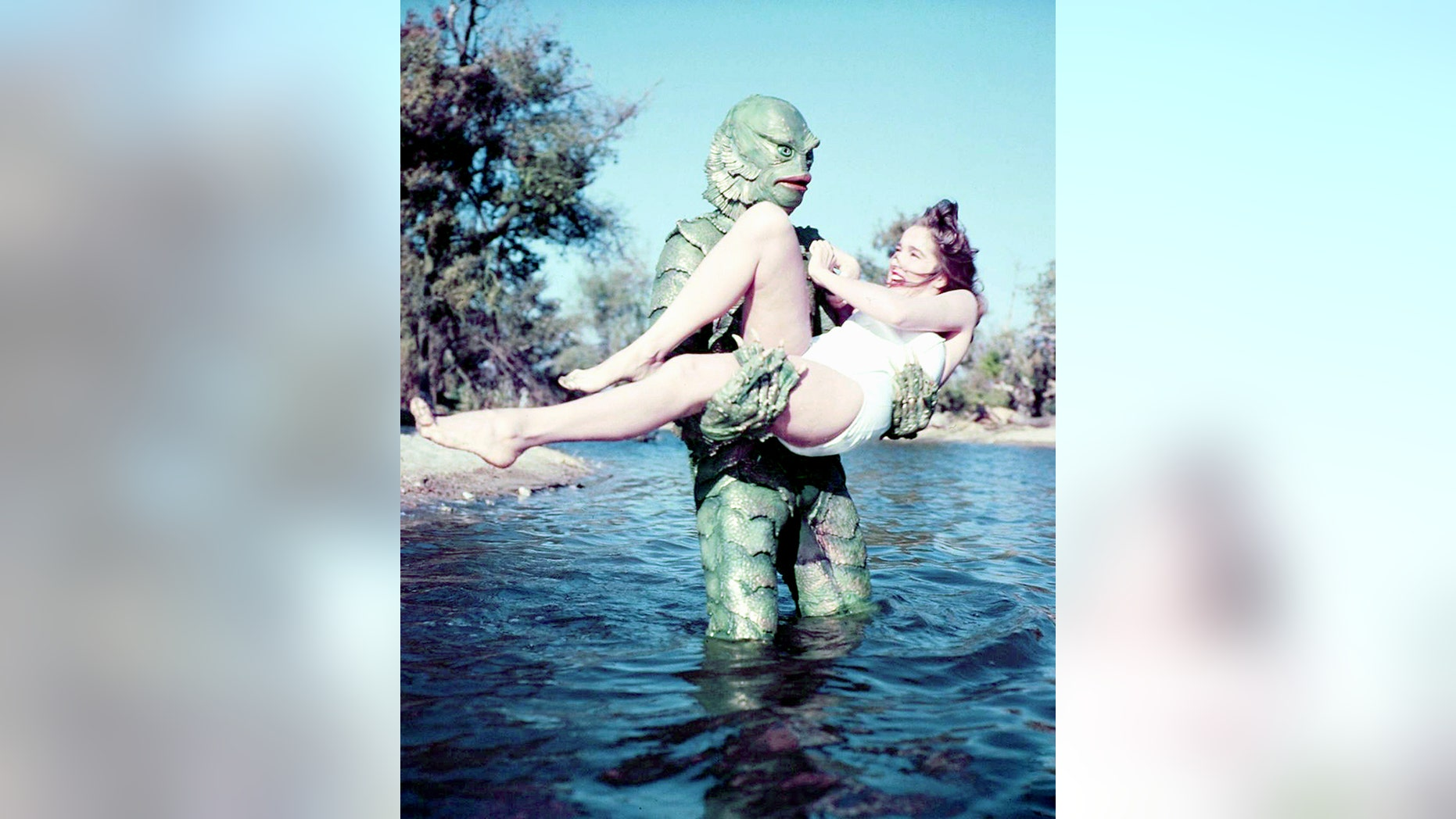 """American actors Ben Chapman (1928 - 2008) as Gill-man, and Julie Adams as Kay Lawrence, in """"Creature From the Black Lagoon,"""" directed by Jack Arnold, 1954."""