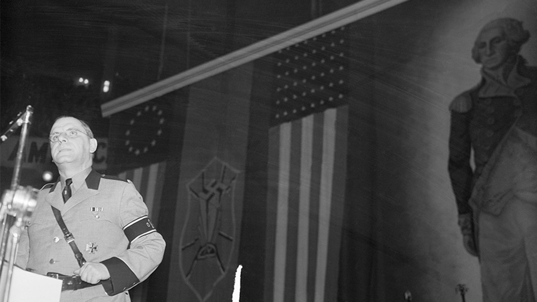 """Fritz Kuhn, local Fuehrer, leader of the German American Bund, addresses the Bund's heavily guarded """"Americanization"""" rally at Madison Square Garden."""