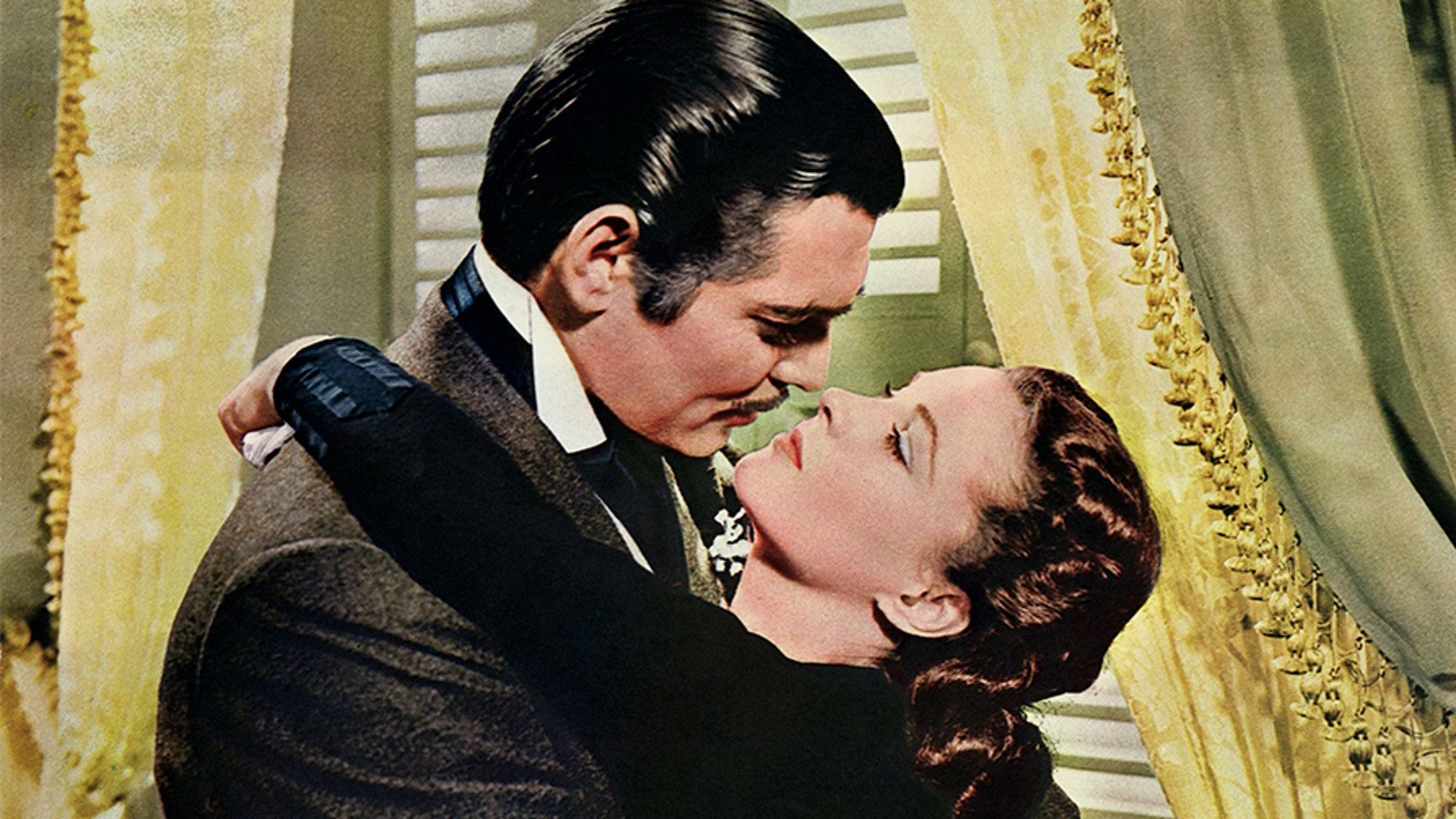 """Rhett Butler (Clark Gable) embraces Scarlett O'Hara (Vivien Leigh) in a famous scene from the 1939 epic film """"Gone with the Wind."""" — Getty"""