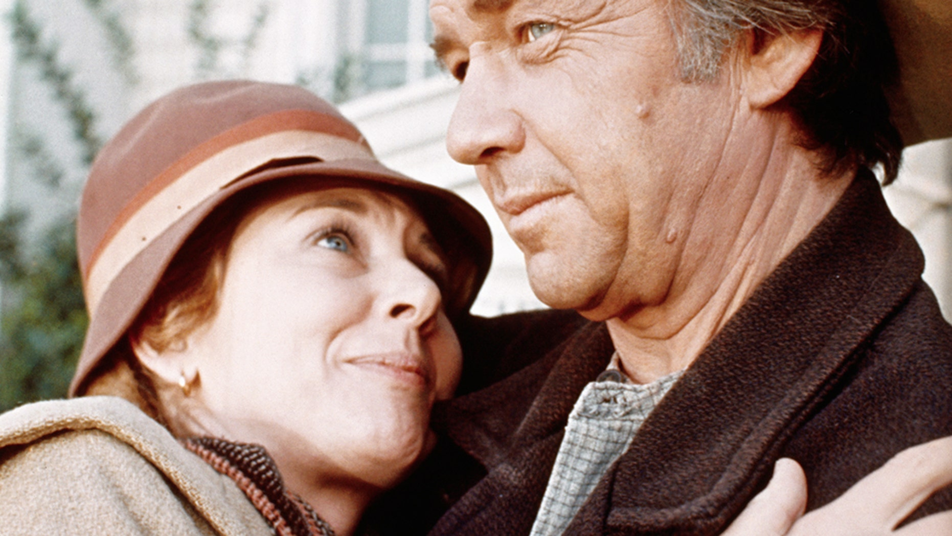 """Actress Michael Learned embraces actor Ralph Waite in scene from the TV series """"The Waltons."""""""