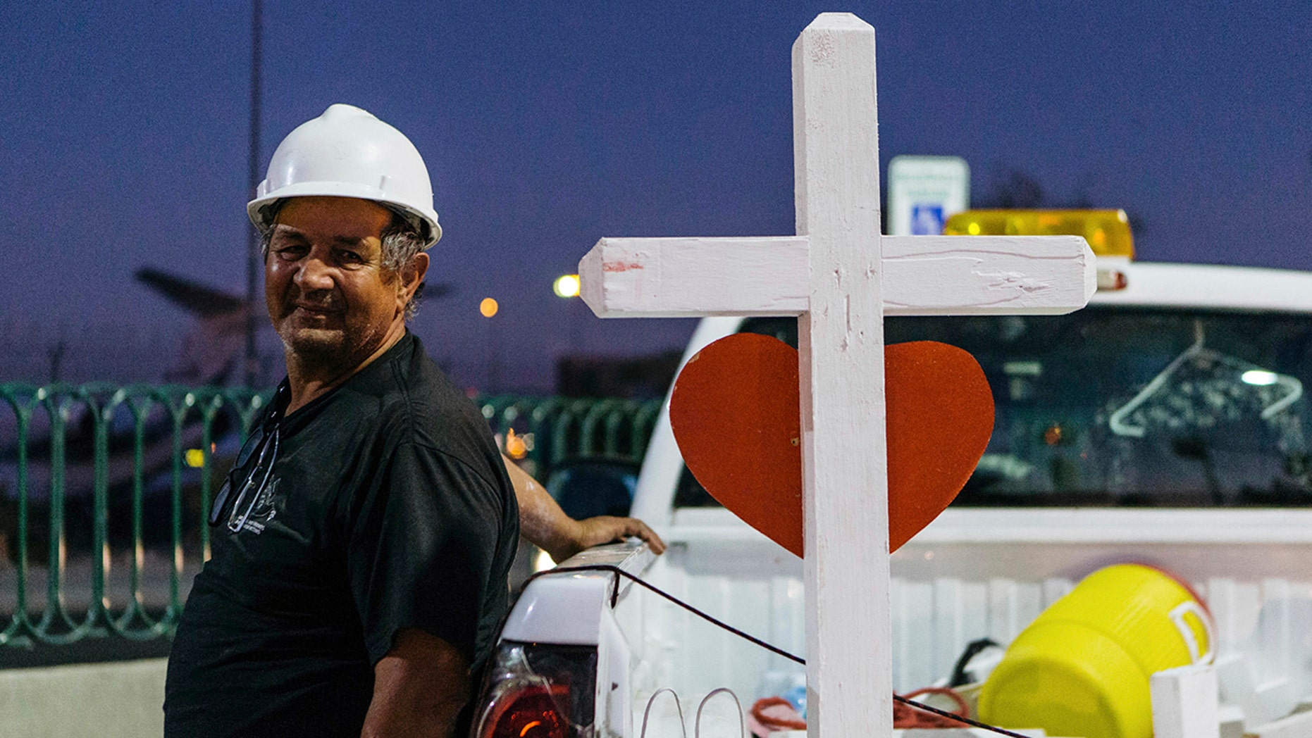 A memorial displaying 58 crosses by Greg Zanis stands at the Welcome To Las Vegas Sign Thursday, Oct. 5, 2017, in Las Vegas. (Mikayla Whitmore/Las Vegas Sun via AP)