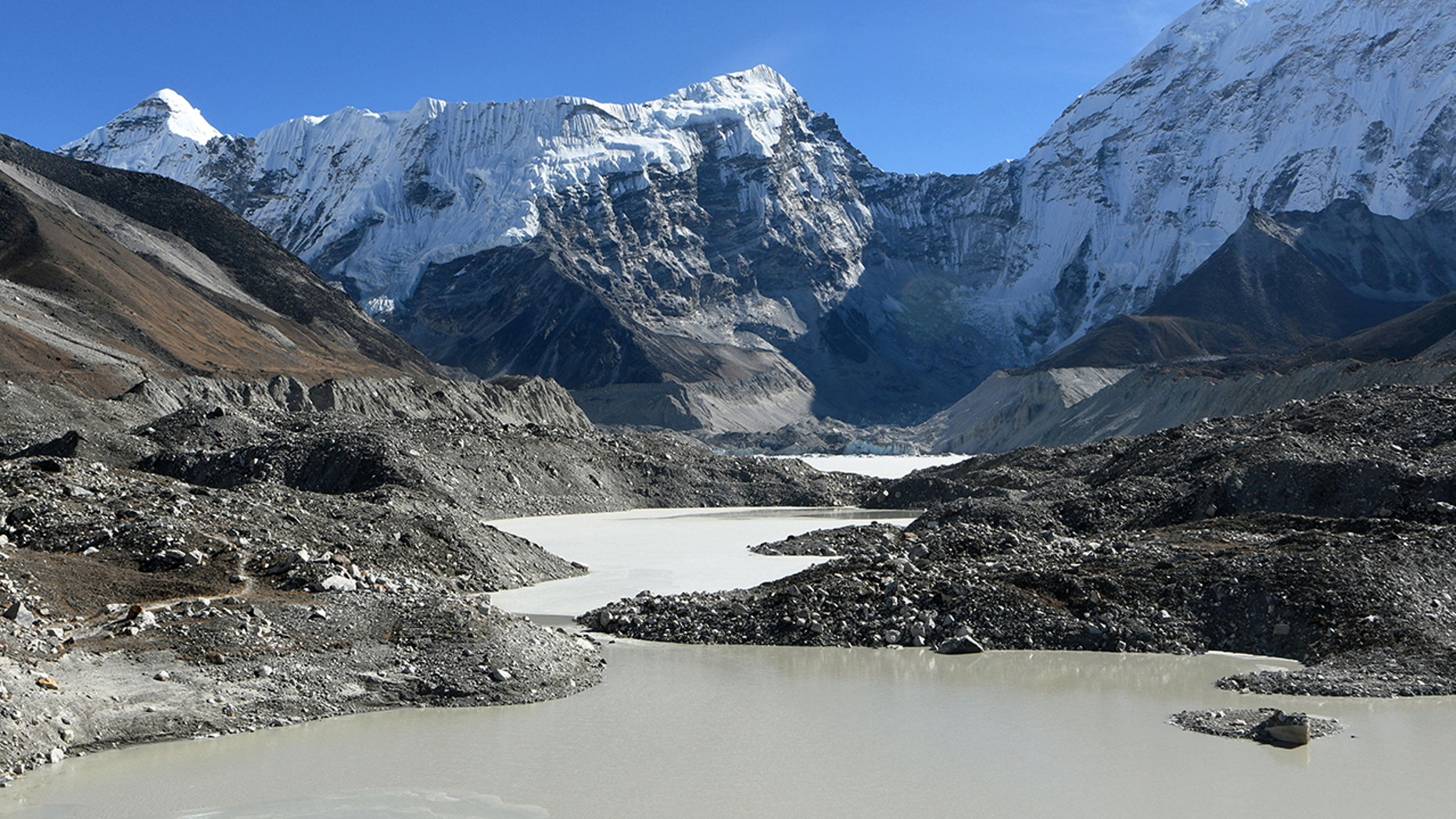 This picture taken on November 22, 2018 shows a general view of the Imja glacial lake controlled exit channel in the Everest region of the Solukhumbu district, some 140km northeast of Kathmandu. - Formed in the shadow of Mount Everest, the turquoise depths of Nepal's Imja glacial lake would be a breathtaking miracle of nature to behold -- were they not a portent of catastrophic floods. (Photo by Prakash MATHEMA / AFP) / TO GO WITH Climate-energy-UN-COP24-Nepal, FOCUS by Paavan MATHEMA (Photo credit should read PRAKASH MATHEMA/AFP/Getty Images)