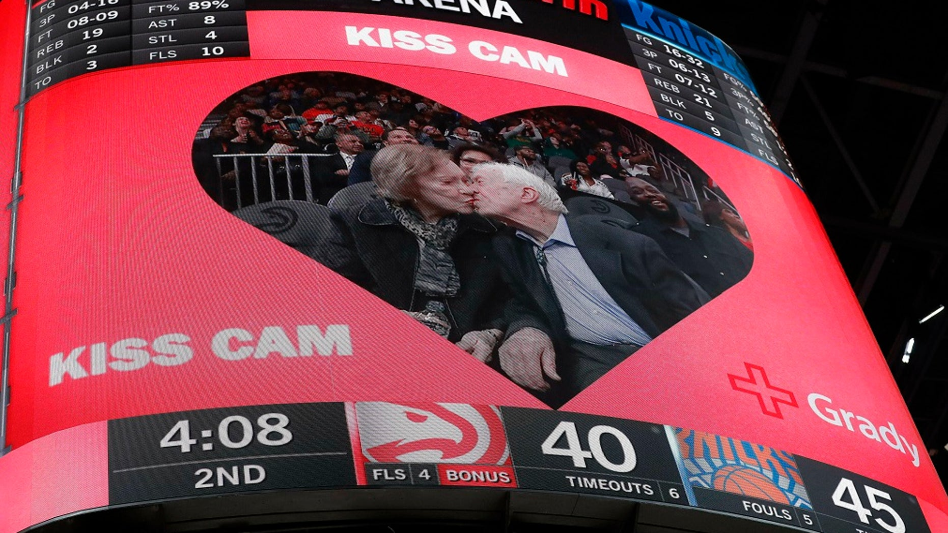 Former President Jimmy Carter and his wife Rosalynn were spotted at the Atlanta Hawks game on Valentine's Day and warmed hearts after they were featured on the kiss cam.