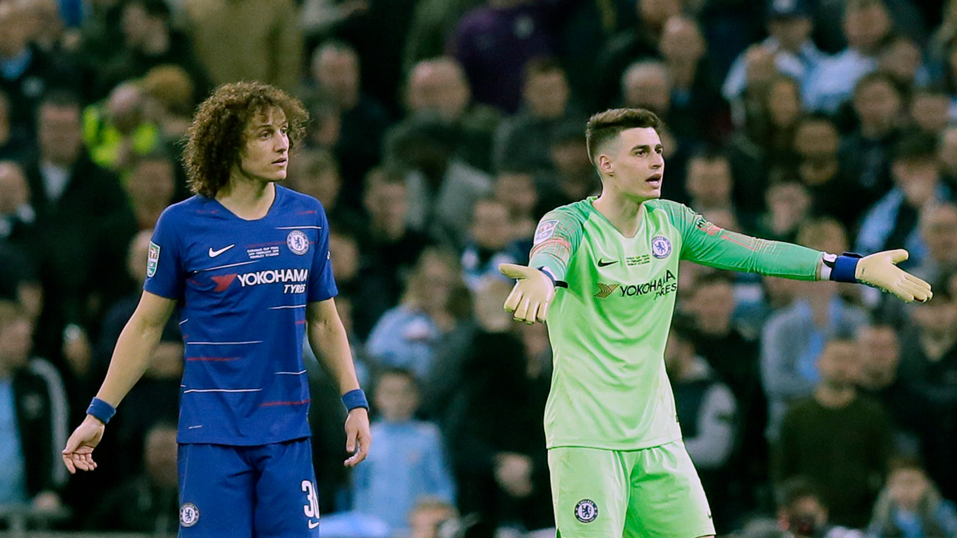 Chelsea goalkeeper Kepa Arrizabalaga, right, gesturing to the bench as captain David Luiz looked on during Sunday's League Cup final against Manchester City. (AP Photo/Tim Ireland