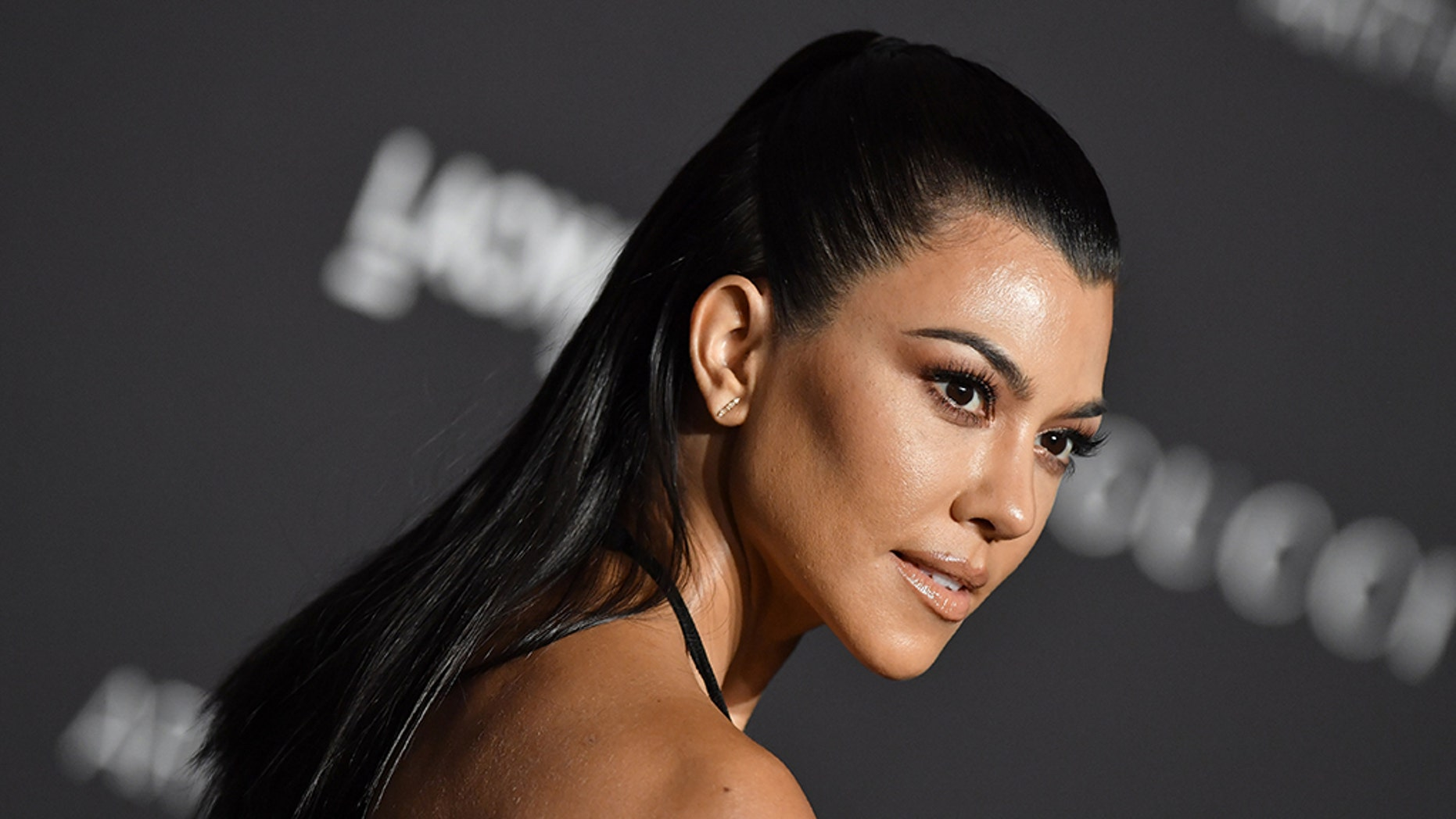 Kourtney Kardashian had a simple reply Friday to an Instagram follower who appeared to mockingly question a photo of her posing in lingerie.