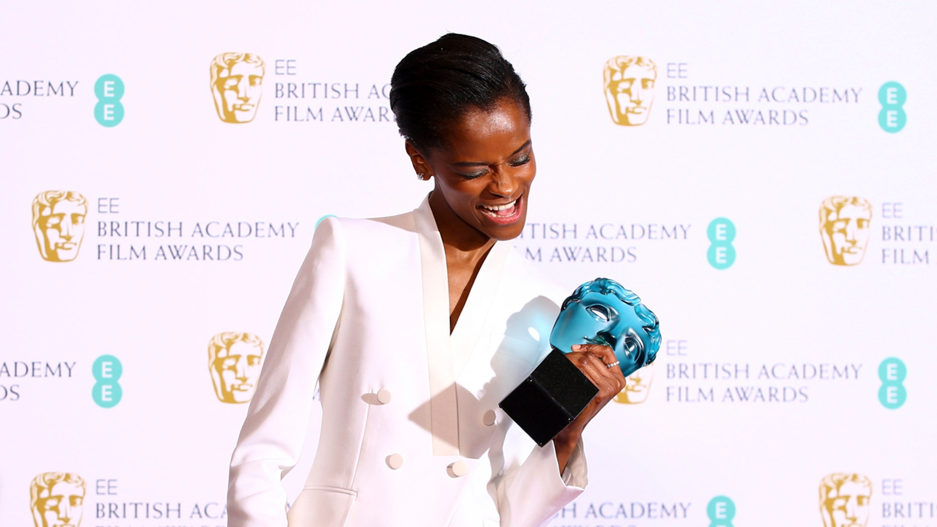 Actress Letitia Wright poses for photographers backstage with her Rising Star award at the BAFTA awards in London, Sunday, Feb. 10, 2019. (Photo by Joel C Ryan/Invision/AP)