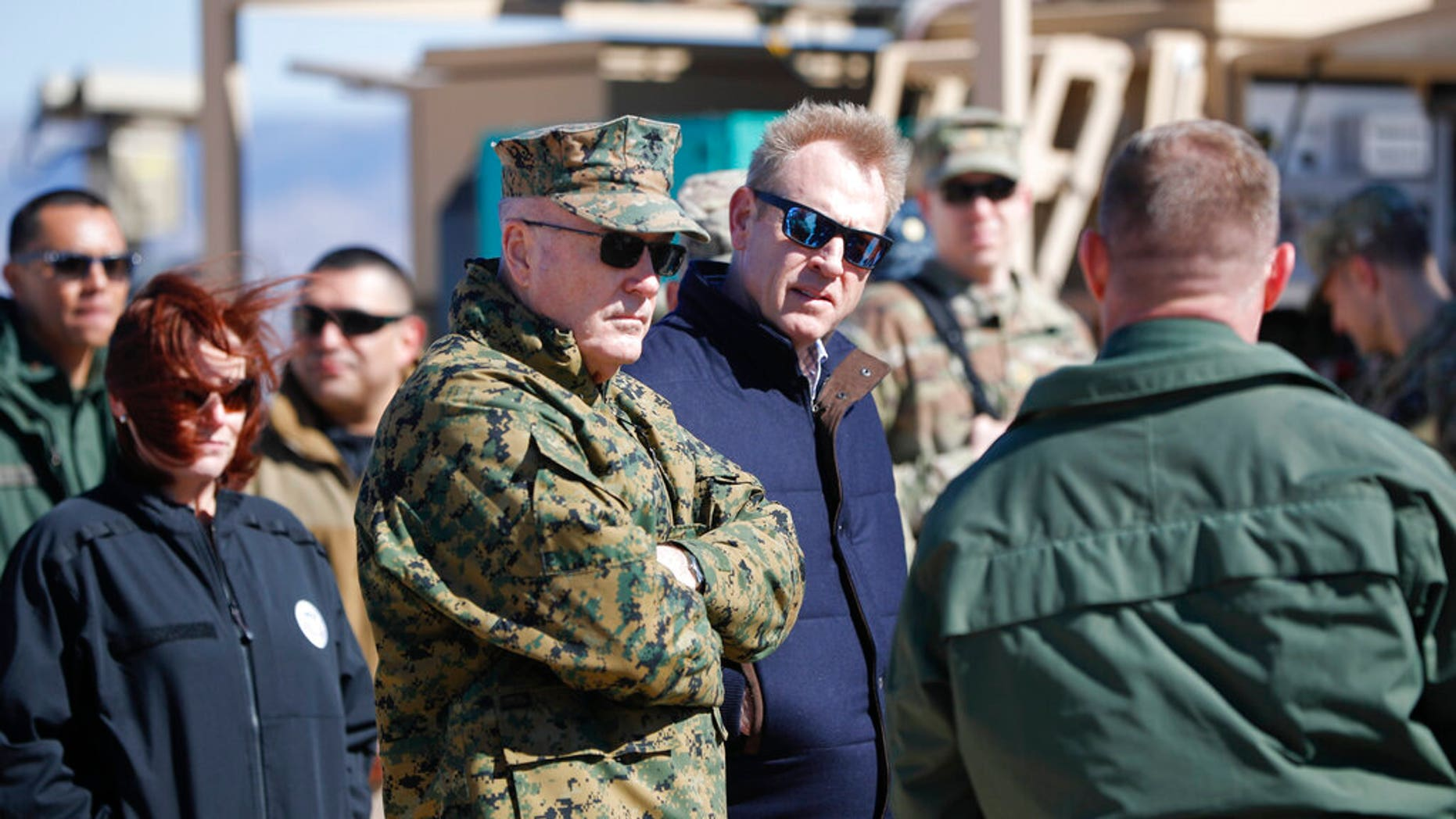 Acting Secretary of Defense Patrick Shanahan, center, and Joint Chiefs Chairman Gen. Joseph Dunford, left, tour the US-Mexico border at Santa Teresa Station in Sunland Park, N.M., Saturday, Feb. 23, 2019. Top defense officials toured sections of the U.S.-Mexico border Saturday to see how the military could reinforce efforts to block drug smuggling and other illegal activity, as the Pentagon weighs diverting billions of dollars for President Donald Trump's border wall. (AP Photo/Pablo Martinez Monsivais)