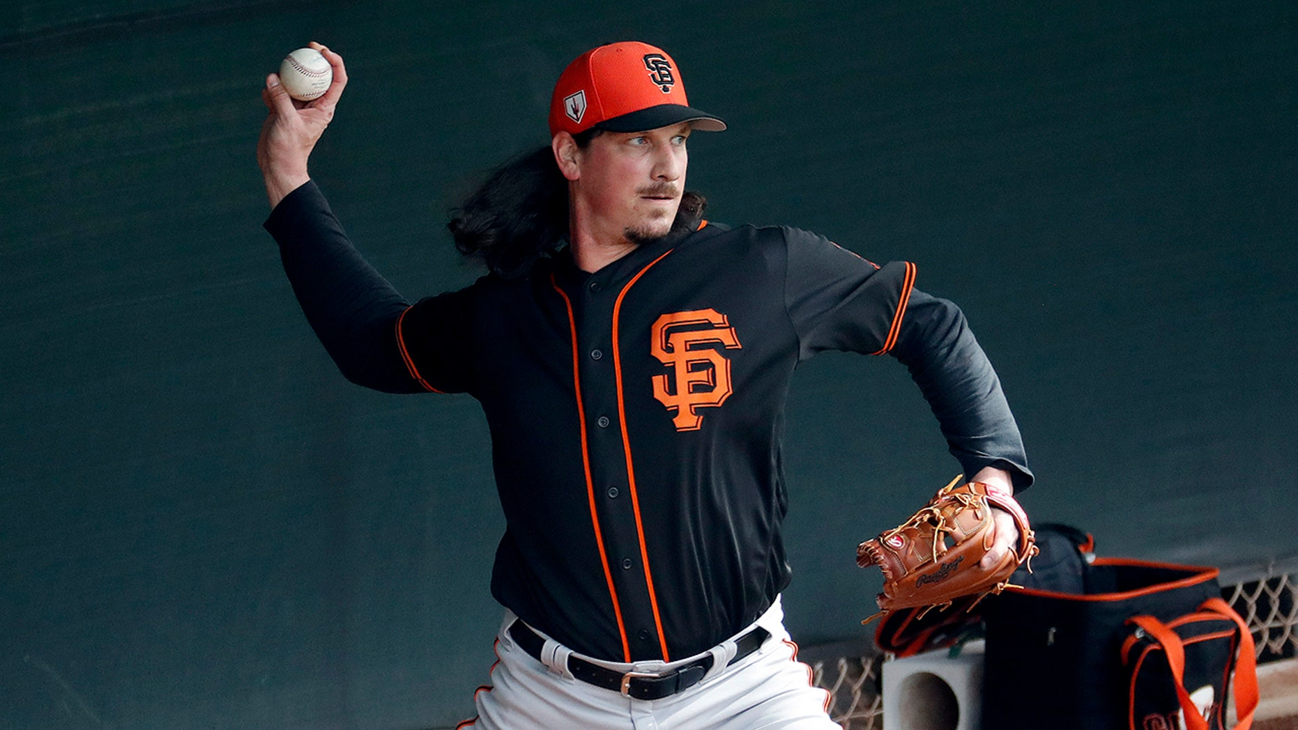 San Francisco Giants pitcher Jeff Samardzija works out during a baseball spring training practice, Wednesday, Feb. 13, 2019, in Scottsdale, Ariz.
