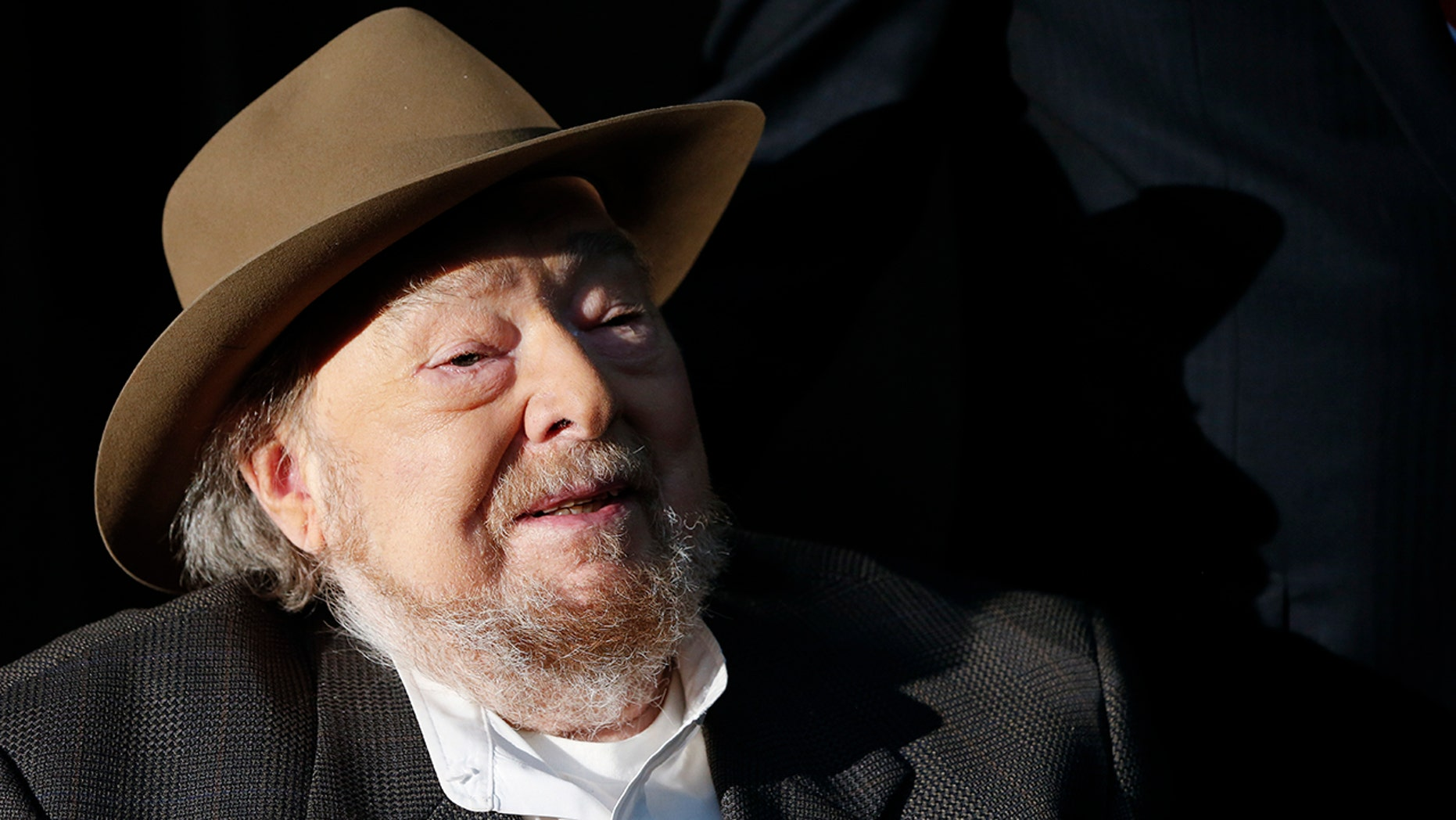 In this April 22, 2014 file photo, Mac Wiseman speaks after he was introduced as one of three new inductees into the Country Music Hall of Fame in Nashville, Tenn. Spring Hill Funeral Home in Nashville, Tenn., says the bluegrass and country vocalist has died at the age of 93. The funeral home said Wiseman died Sunday, Feb. 24, 2019.