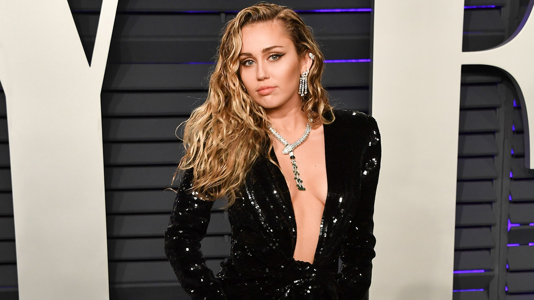 Miley Cyrus: Miley Cyrus Stuns At Vanity Fair Oscars Party In Low-cut