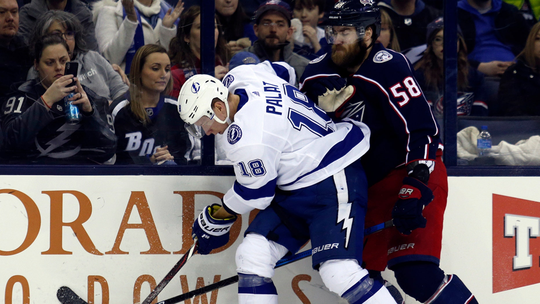 Tampa Bay Lightning forward Ondrej Palat, left, of the Czech Republic, works against Columbus Blue Jackets defenseman David Savard during the second period of an NHL hockey game in Columbus, Ohio, Monday, Feb. 18, 2019.
