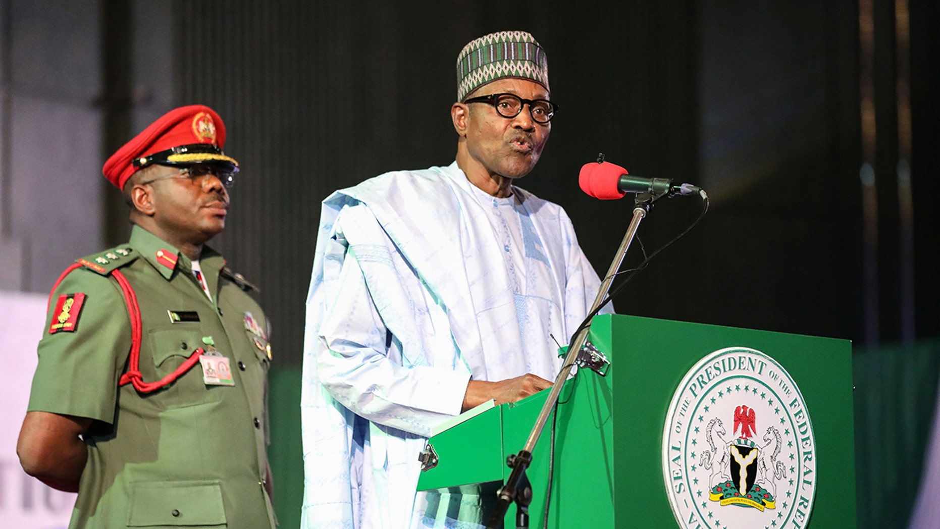 Nigerian President Muhammadu Buhari addresses the audience following his re-election, after Nigeria's Independent National Electoral Commission presented his certificate of election on February 27, 2019, in Abuja. (KOLA SULAIMON/AFP/Getty Images)