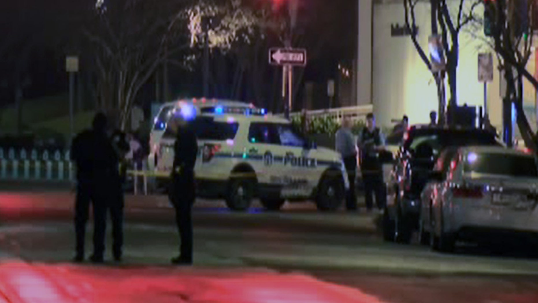 Police officers respond to the shooting in New Orleans' central business district Sunday night