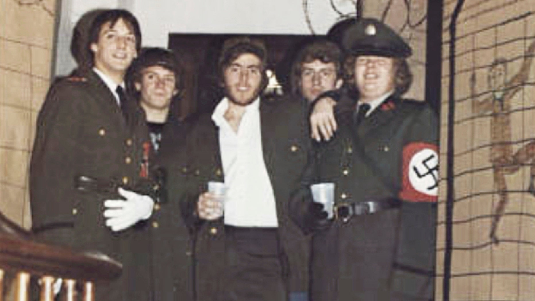 In this photo from the 1980 edition of Spectrum, the Gettysburg College yearbook, Bob Garthwait, right, wears a costume that depicts a Nazi uniform at a fraternity event. Garthwait, a financial donor and college trustee, apologized and announced his resignation from the board of trustees Tuesday, Feb. 19, 2019. (Spectrum/Gettysburg College via AP)