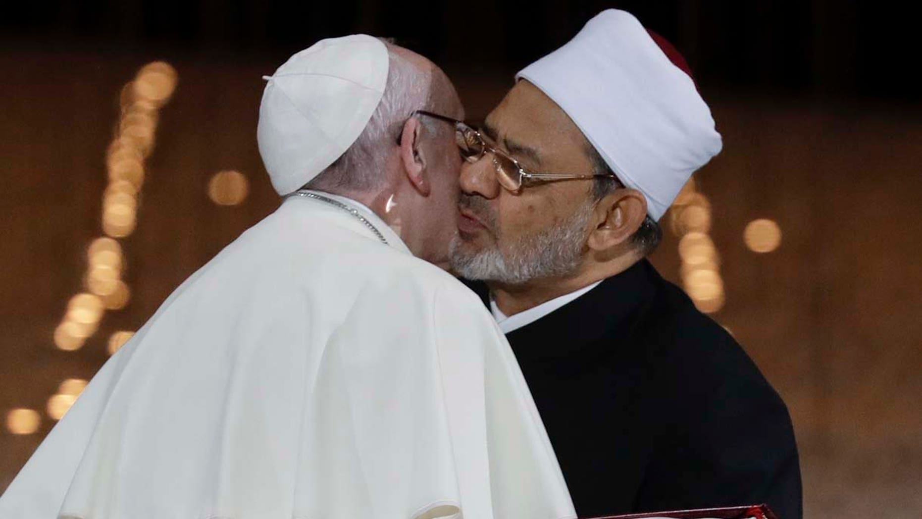 Pope Francis hugs Sheikh Ahmed el-Tayeb, the grand imam of Egypt's Al-Azhar, after an Interreligious meeting at the Founder's Memorial in Abu Dhabi, United Arab Emirates, Monday, Feb. 4, 2019. Pope Francis has asserted in the first-ever papal visit to the Arabian Peninsula that religious leaders have a duty to reject all war and commit themselves to dialogue. (AP Photo/Andrew Medichini)