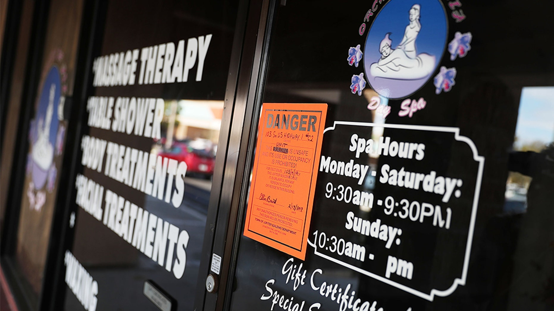 A Danger sign seen on the front door of the Orchids of Asia Day Spa last week in Jupiter, Fla., in connection to New England Patriots owner Robert Kraft being charged with allegedly soliciting for sex. (Photo by Joe Raedle/Getty Images)