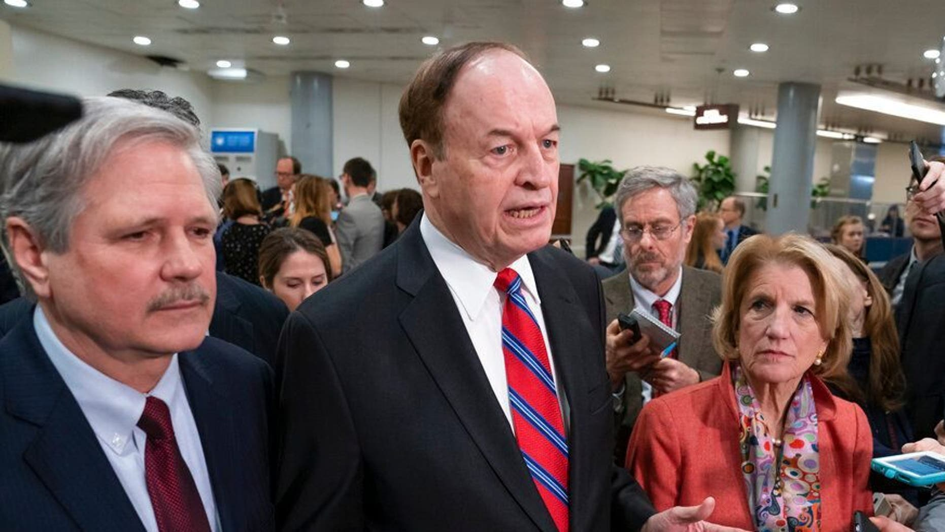 In this Feb. 6, 2019, photo, Sen. Richard Shelby, R-Ala., the top Republican on the bipartisan group bargainers working to craft a border security compromise in hope of avoiding another government shutdown, is joined by Sen. John Hoeven, R-N.D., left, and Sen. Shelley Moore Capito, R-W.Va., right, as they speak with reporters in Washington. (AP Photo/J. Scott Applewhite)