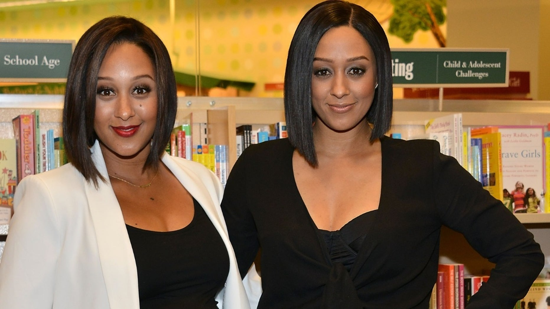 Tamera Mowry-Housley [left] drank her twin sister Tia Mowry-Hardrict's [