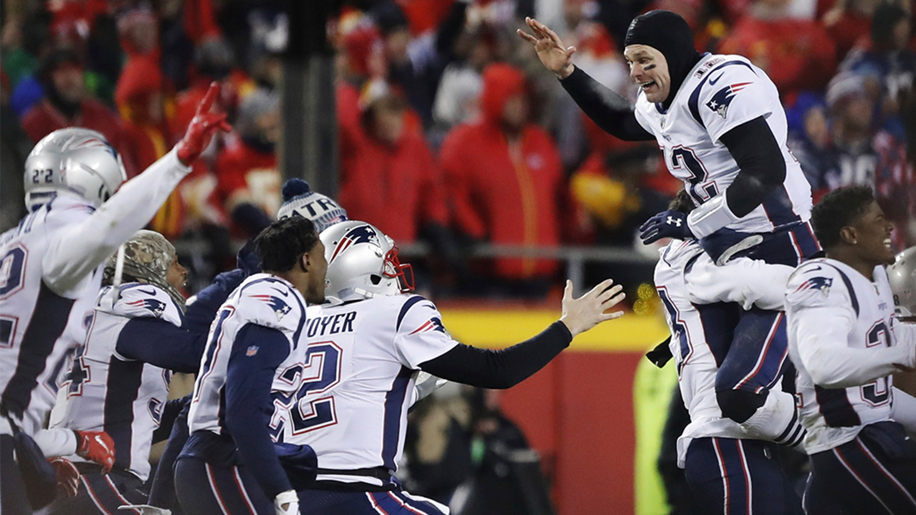 FILE - In this Jan. 20, 2019, file photo, New England Patriots quarterback Tom Brady (12) celebrates with his teammates after the AFC Championship NFL football game, in Kansas City, Mo. With five rings Tom Brady has already established himself as the most-decorated quarterback in Super Bowl history. (AP Photo/Charlie Neibergall, File)174