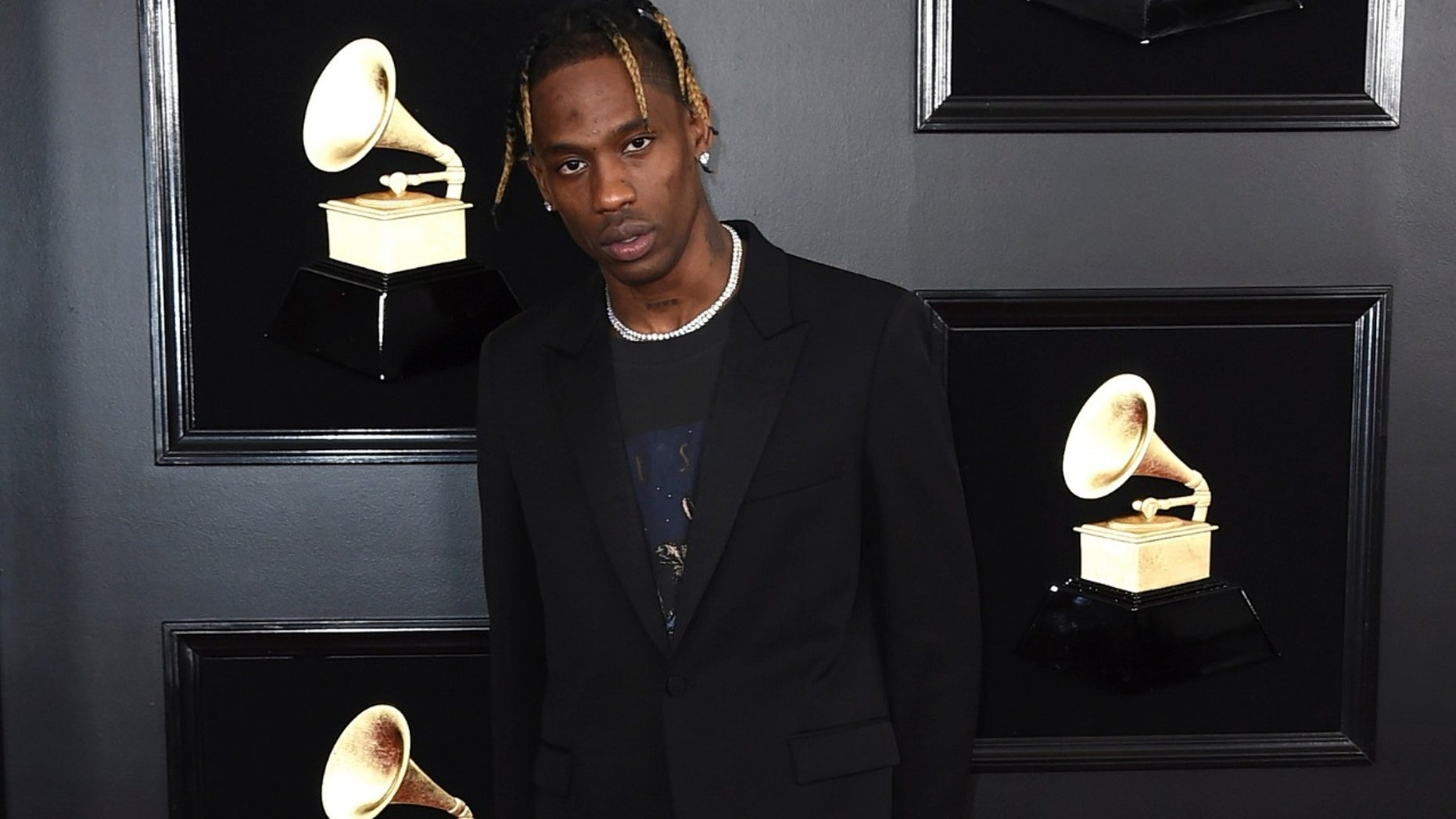 Oklahoma police shot pepper balls to disperse a crowd that rushed the doors of an arena after rapper Travis Scott abruptly postponed a sold-out concert on Monday night.
