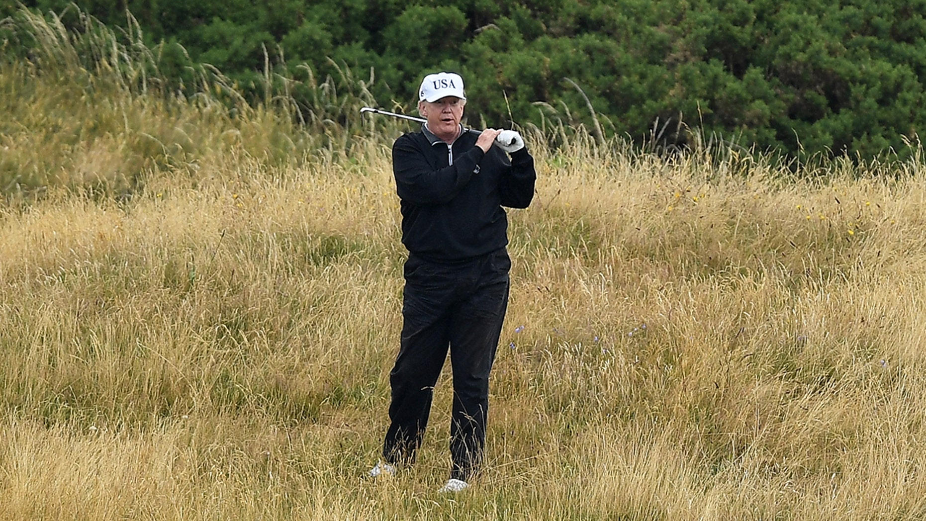 TURNBERRY, SCOTLAND - JULY 15: U.S. President Donald Trump plays a turn of golf during Trump Turnberry Luxury Collection Resort during a U.S. President's initial central revisit to a United Kingdom on Jul 15, 2018 in Turnberry, Scotland. (Photo by Leon Neal/Getty Images)