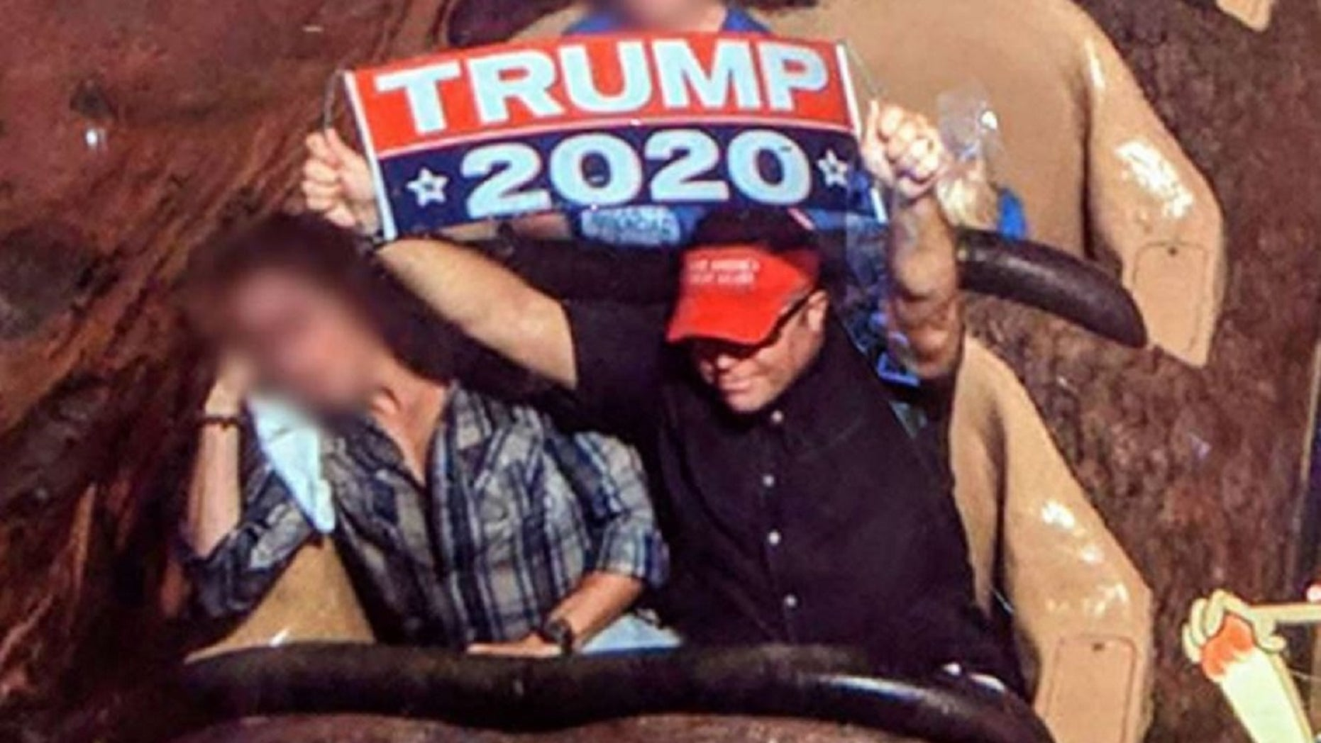"""Dion Ciniwas ejected from Disneyland for unfurling a large """"Trump2020"""" banner at the park."""