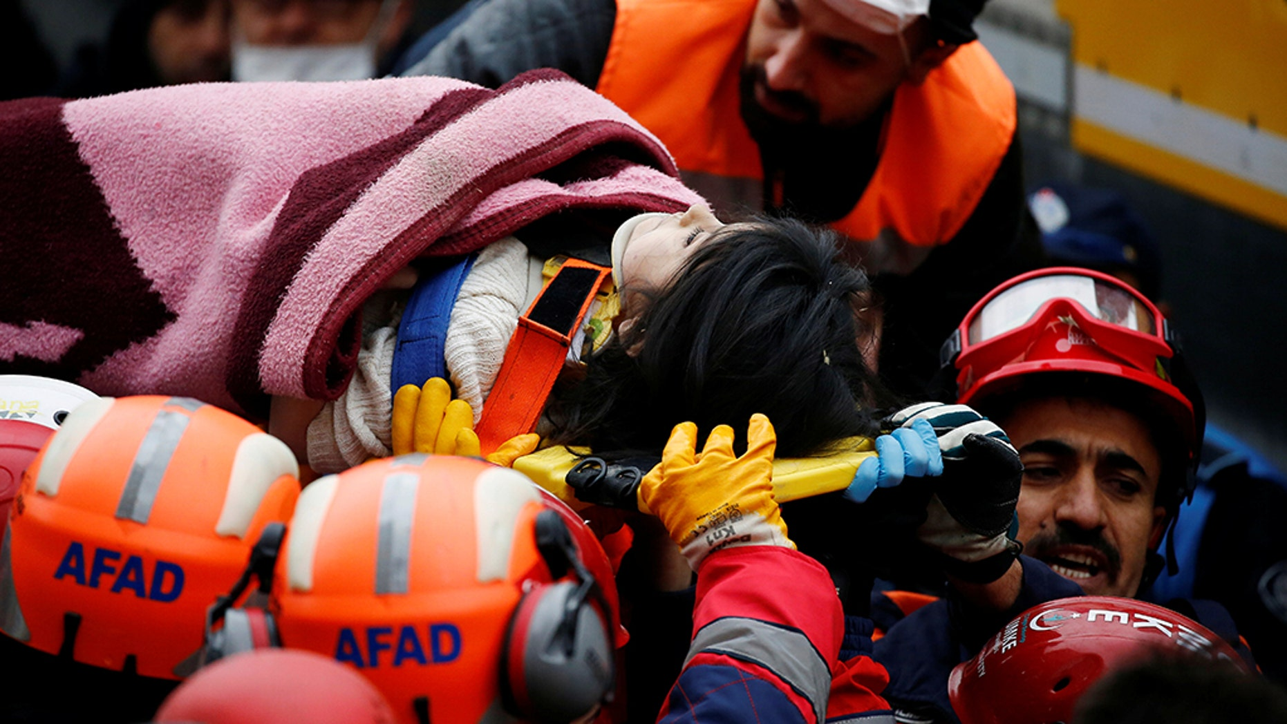 Rescuers carry a girl on a stretcher at the site of a collapsed residential building in the Kartal district, Istanbul, Turkey, February 7, 2019.