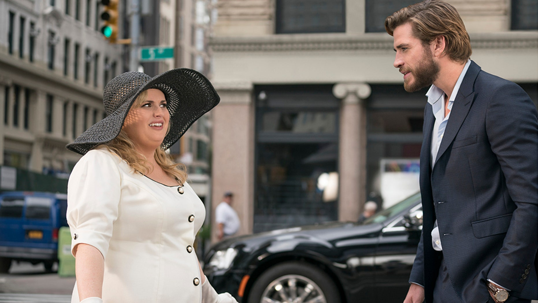 "This image released by Warner Bros. Pictures shows Rebel Wilson, left, and Liam Hemsworth in a scene from ""Isn't It Romantic."" (Michael Parmelee/Warner Bros. Pictures via AP)"