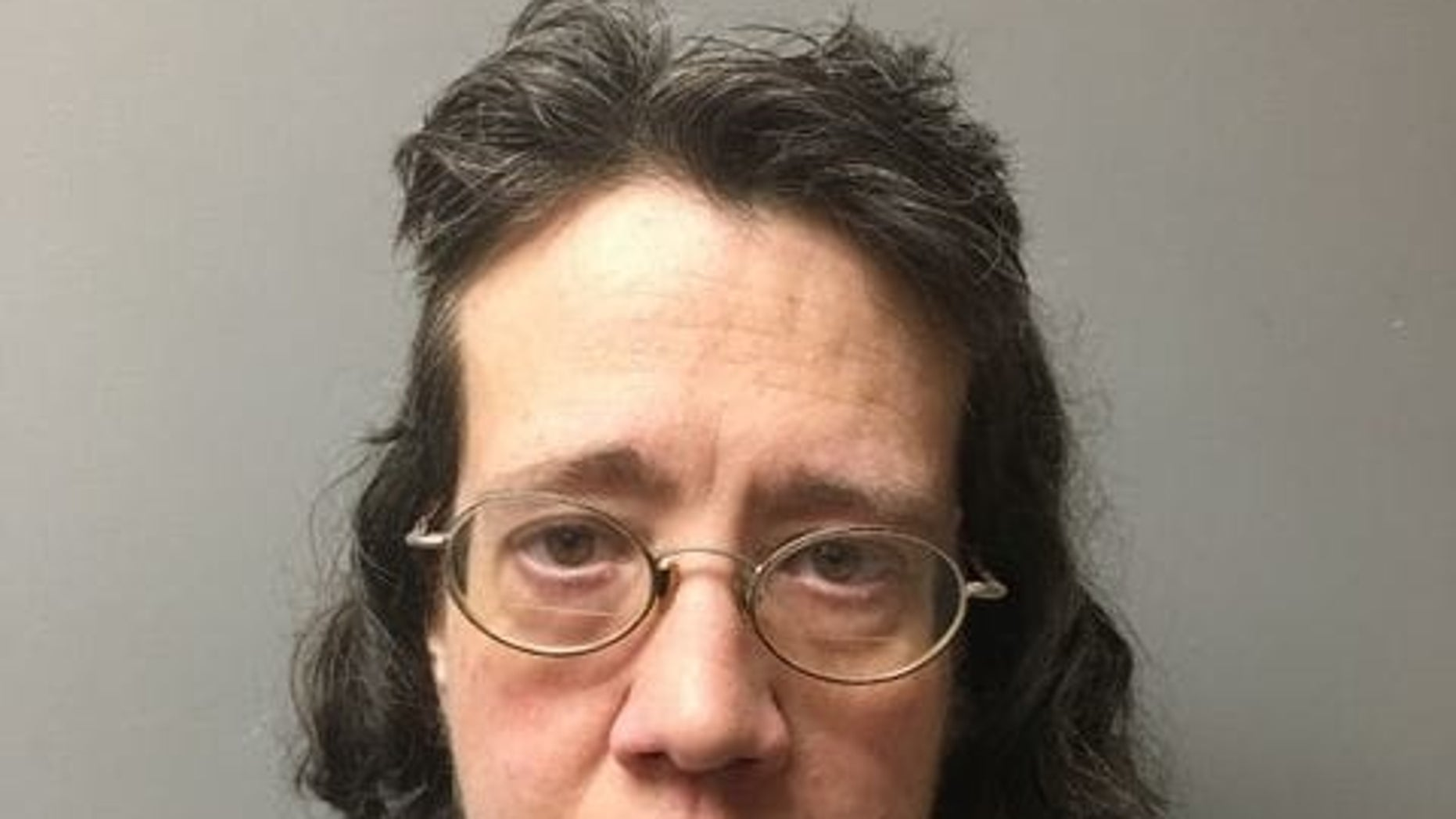 Jo-Whitney Outland, 55, of Bristol, Va., was accused of hiding her mother's decomposing body inside their home for weeks, covering it with dozens of blankets and surrounding it with air fresheners to mask the smell.