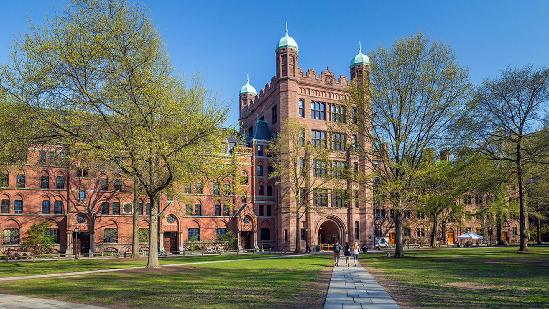 Three female students filed a class-action lawsuit against Yale University and nine all-male fraternities on Tuesday in an attempt to stop the social organizations from admitting people based on their gender.