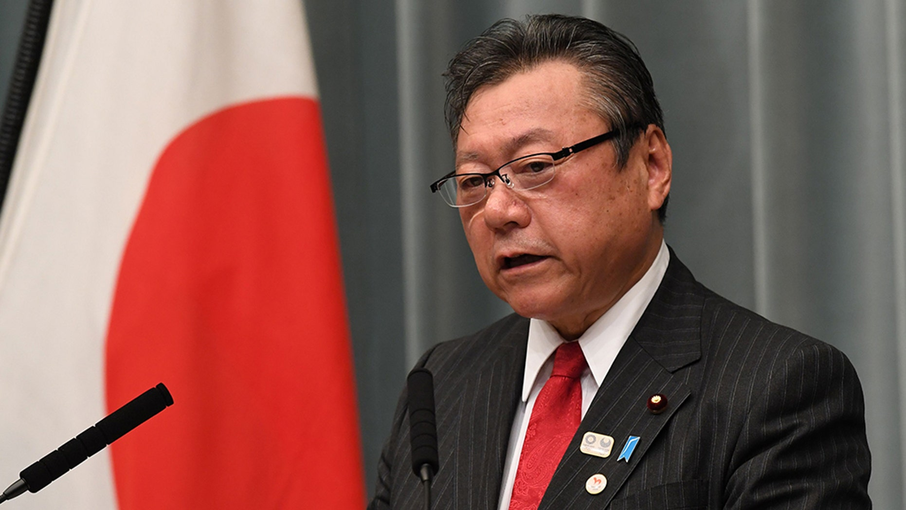 Japanese Olympic Minister Yoshitaka Sakurada has been forced to apologize after arriving three minutes late to a parliamentary meeting on Thursday
