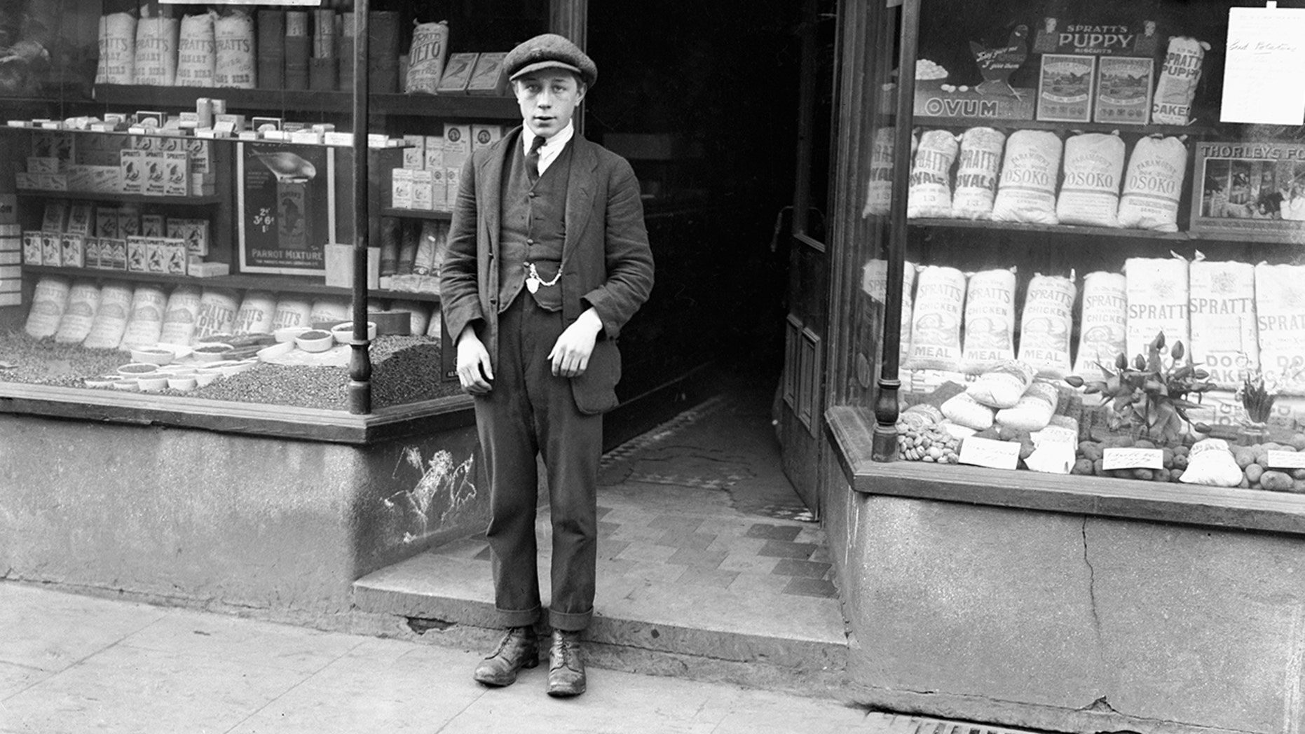 The accused, 15-year-old Harold Jones, was tried and acquitted of Freda's murder and went on to kill Florie Little within a few weeks of his release. Pictured is the accused boy at the time of the inquest into Freda Burnell's murder, standing outside Mortimer's Corn Stores in Somerset Street where he was working when the young girl entered, on an errand for her father. 9th February 1921. (Photo by Daily Mirror/Mirrorpix/Mirrorpix via Getty Images)