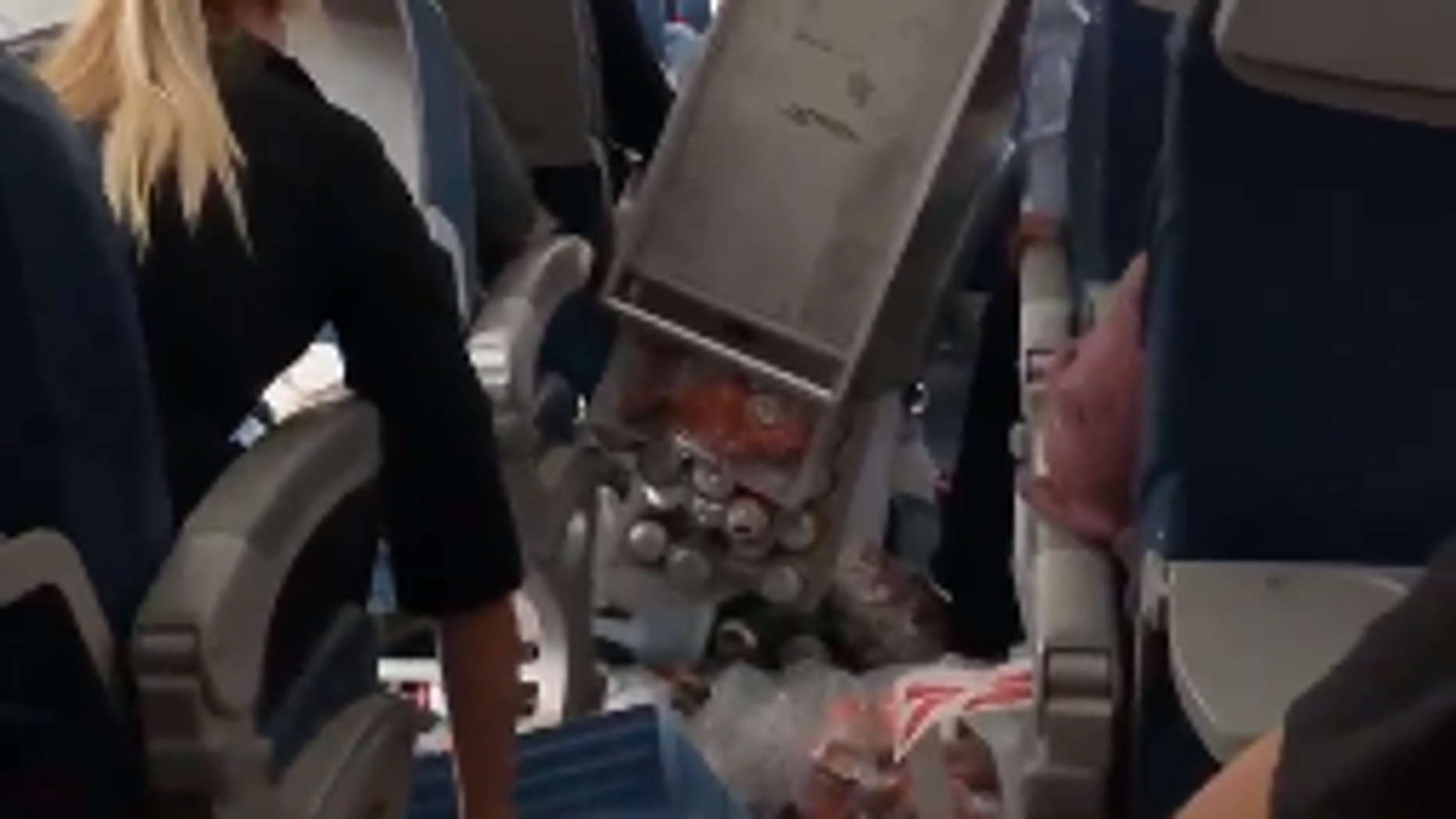 Video from a passengers phone shows the chaotic onboard the flight 5763.