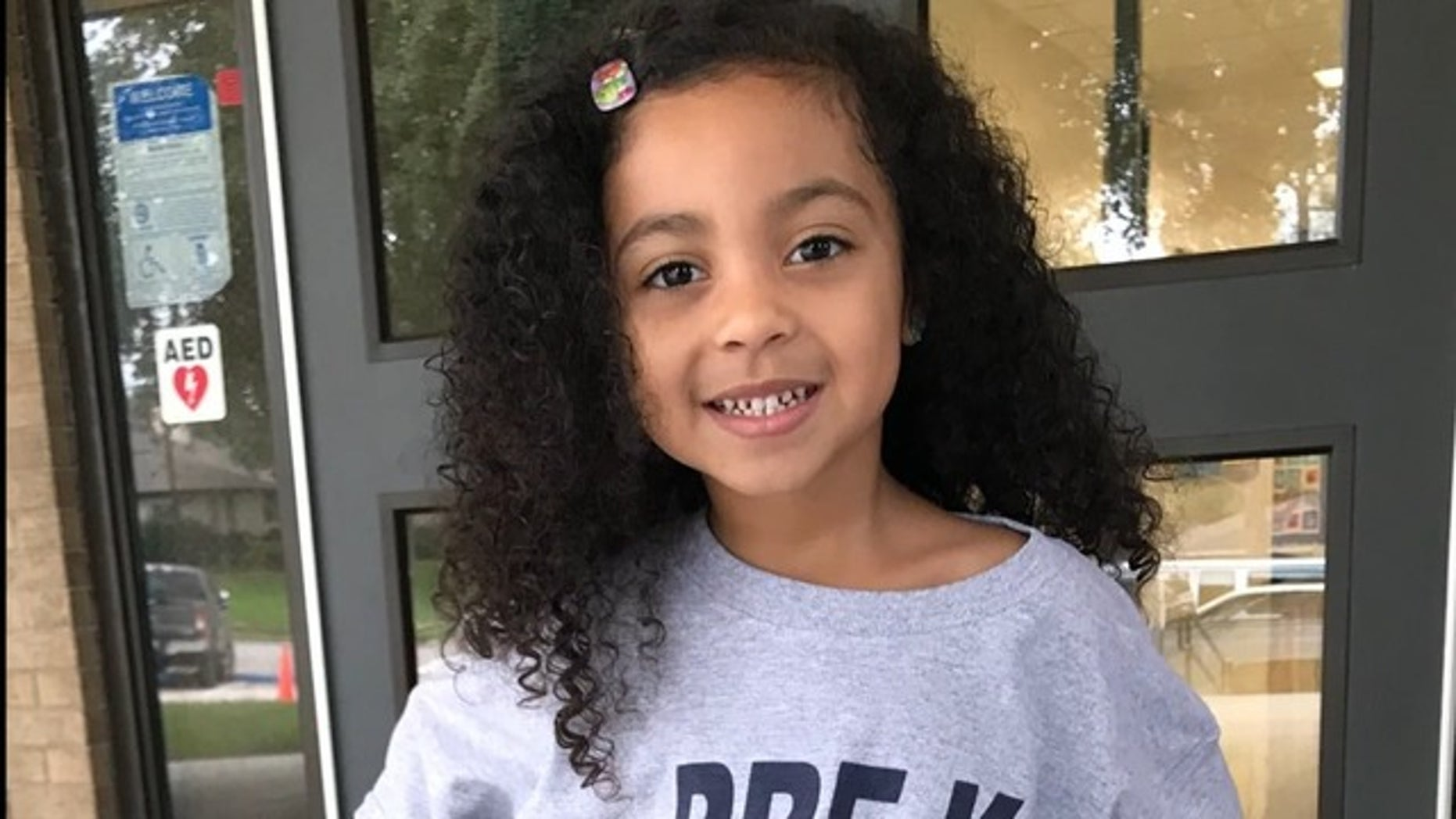 Ashanti Grinage had started showing symptoms of a cold on Sunday, but did not develop a fever until Tuesday, her family said.