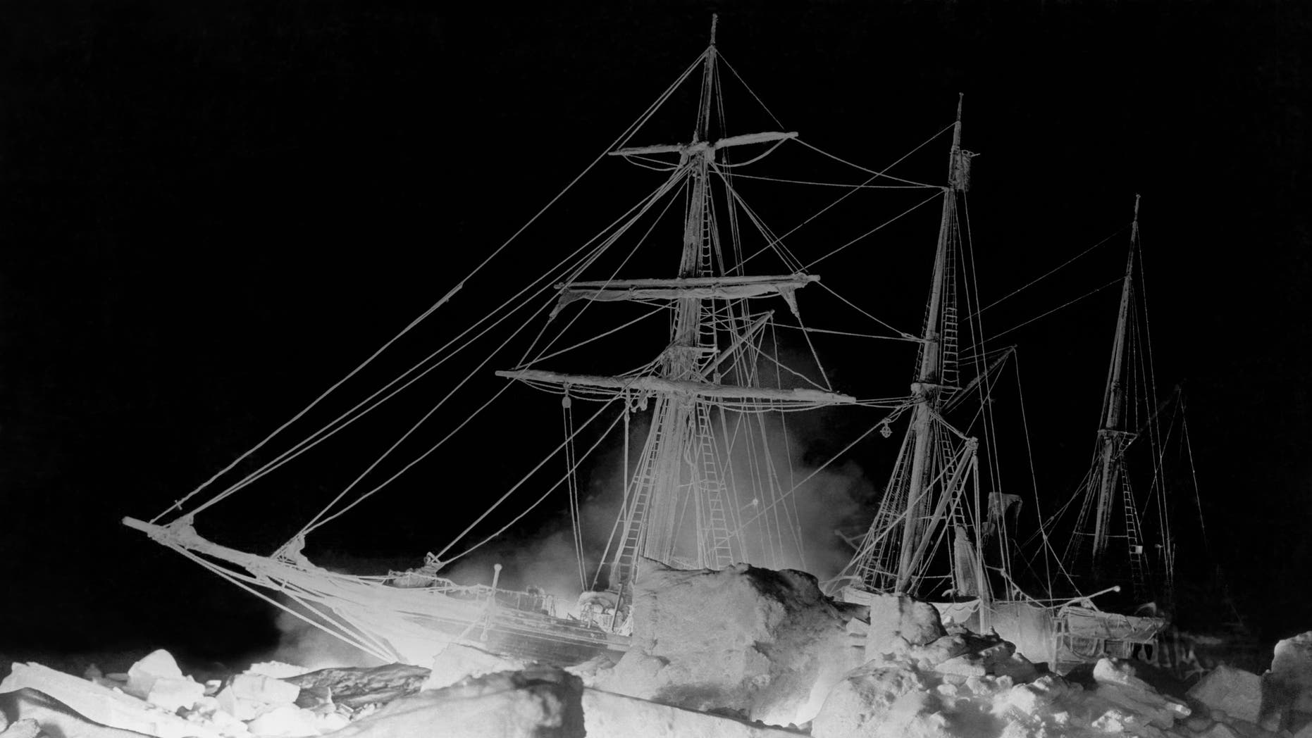 Shackleton's ship, the Endurance, locked in the Weddell Sea, where it finally sank, Antarctica, August 27, 1915. The remarkable lighting was furnished by an oil fire at the bow and a great deal of flash (gun) powder. (Photo by Underwood Archives/Getty Images)