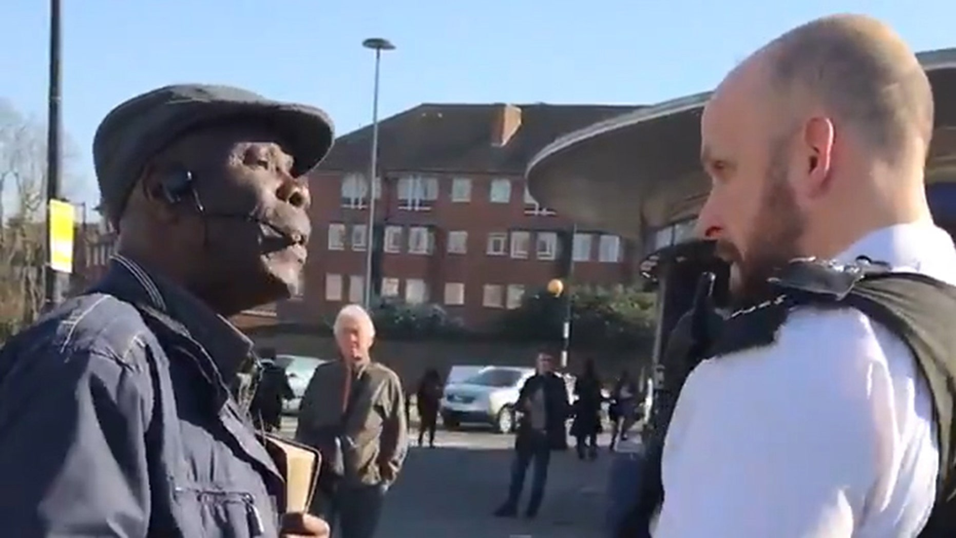 """VIDEO STILLS - This is the moment a Christian preacher was handcuffed and arrested outside a London underground station after complaints he was """"Islamophibic."""""""