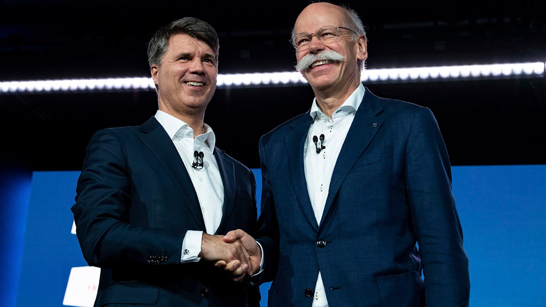 BMW CEO Harald Krueger, left, and Mercedes-Benz CEO Dieter Zetsche of Daimler, right, announced the agreement in Berlin.