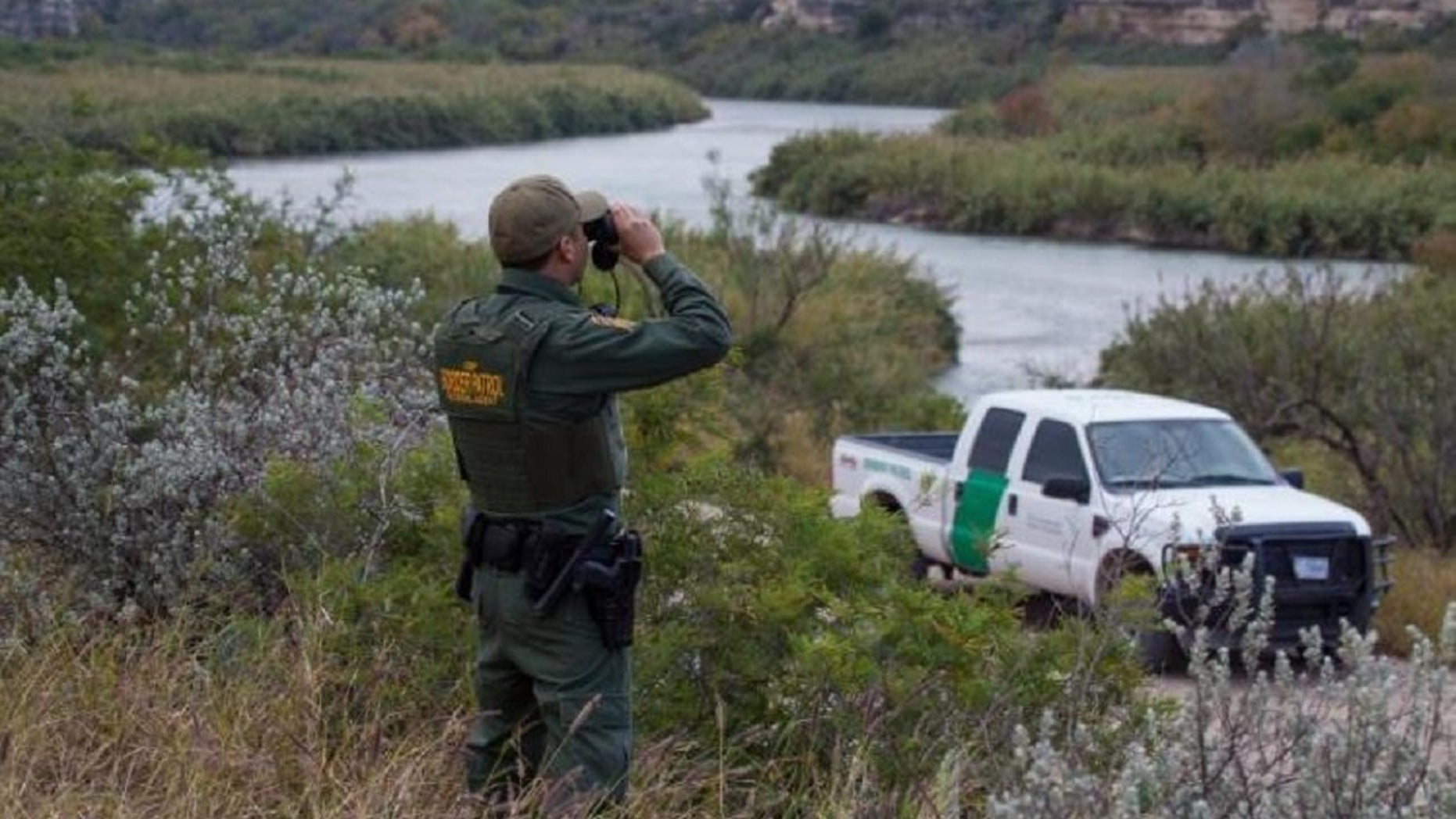 A Border Patrol agent overlooks Mexico from Eagle Pass, Texas. A Honduran woman detained while trying to cross into the U.S. illegally claims she was kidnapped and held for ransom by human smugglers in Mexico.