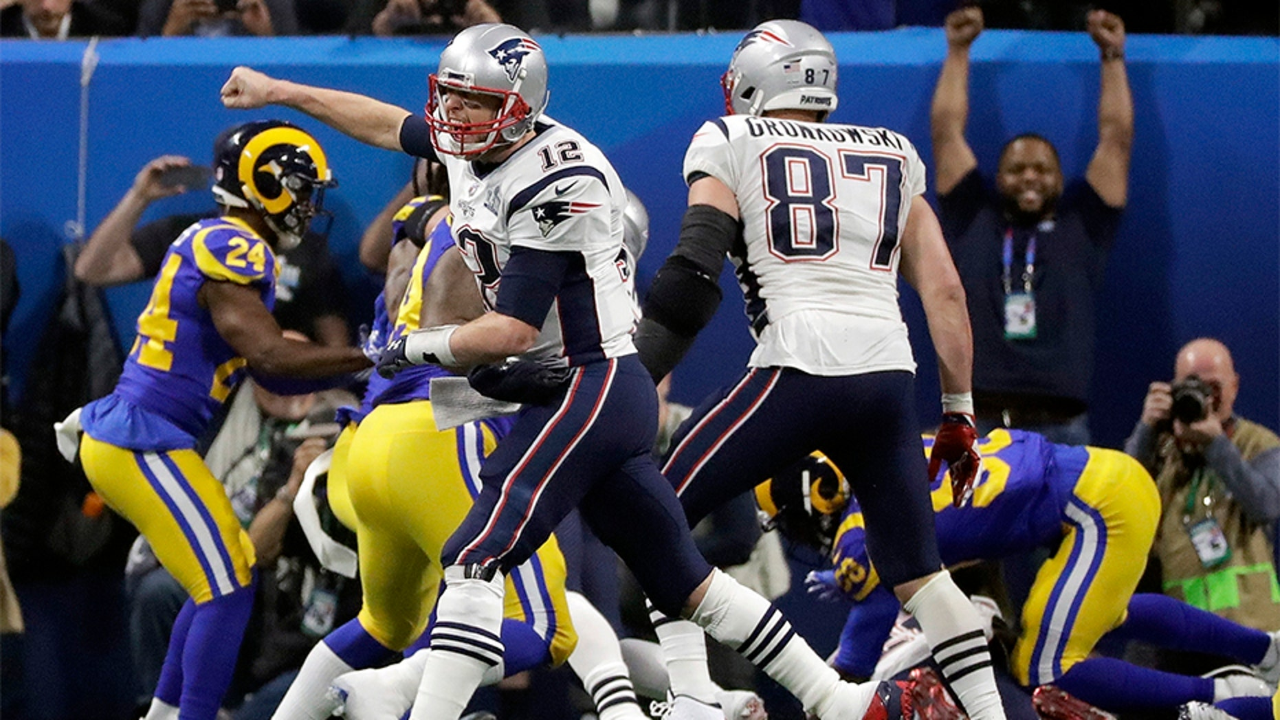 New England Patriots' Tom Brady celebrates a touchdown run by Sony Michel during the second half of the NFL Super Bowl 53 football game against the Los Angeles Rams.