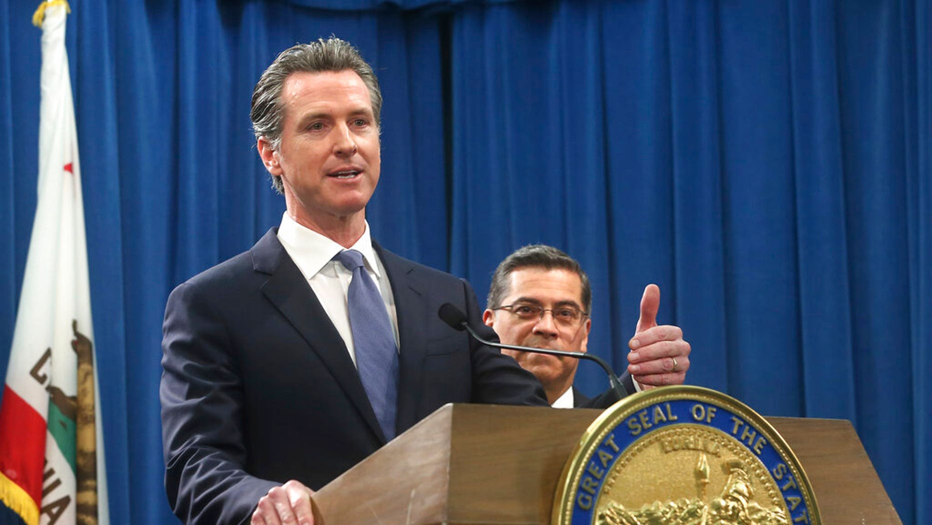 California Gov. Gavin Newsom, left, flanked by Attorney General Xavier Becerra, right, answers a doubt concerning a lawsuit a state will expected record opposite President Donald Trump over his puncture stipulation to account a wall on a U.S.-Mexico limit Friday, Feb. 15, 2019, in Sacramento, Calif. Newsom and Becerra both contend there is no puncture during a limit and Trump doesn't have a management to make a declaration. (AP Photo/Rich Pedroncelli)