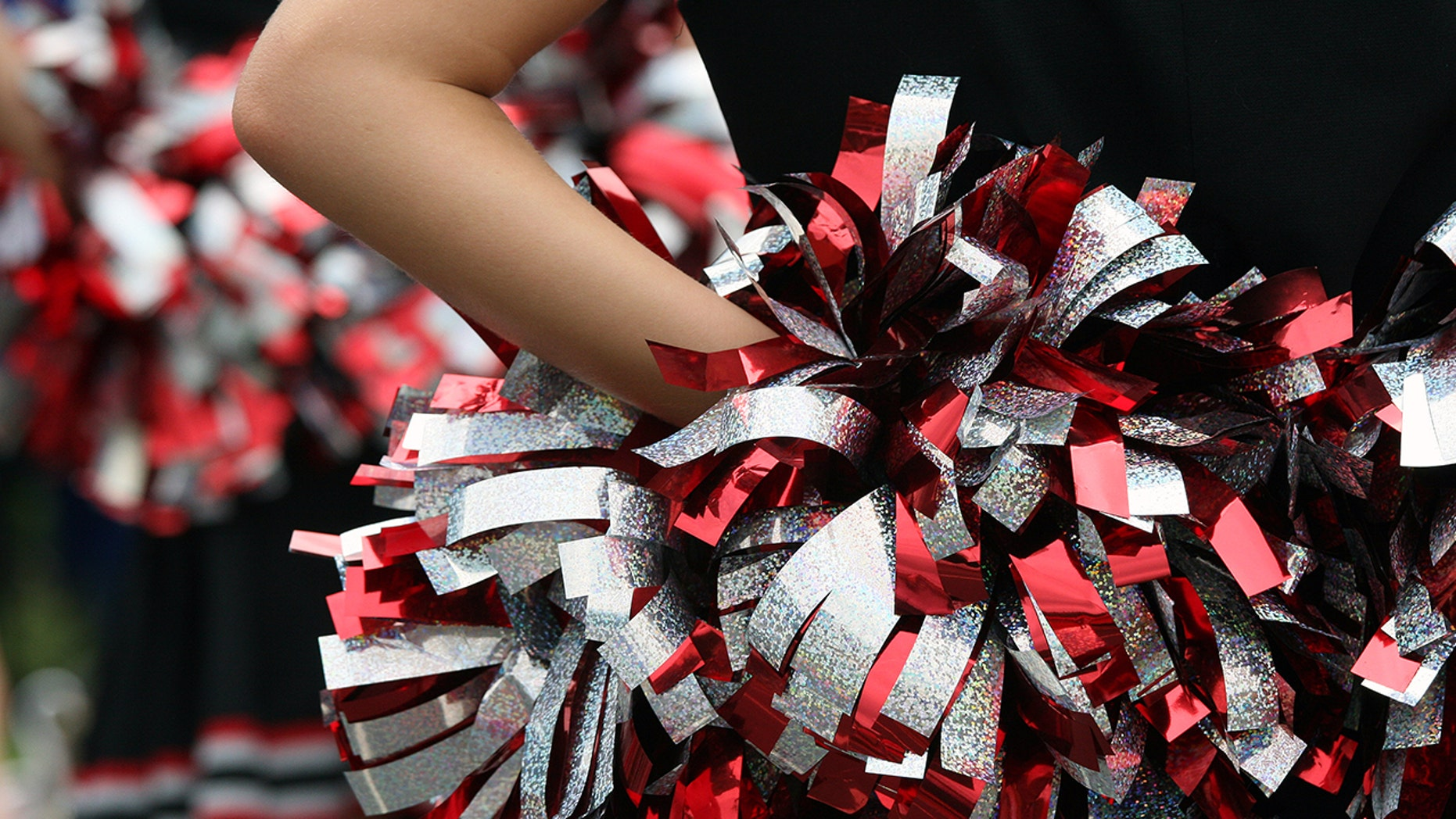 A high school in Wisconsin is under fire from simulated reviews given to cheerleaders.