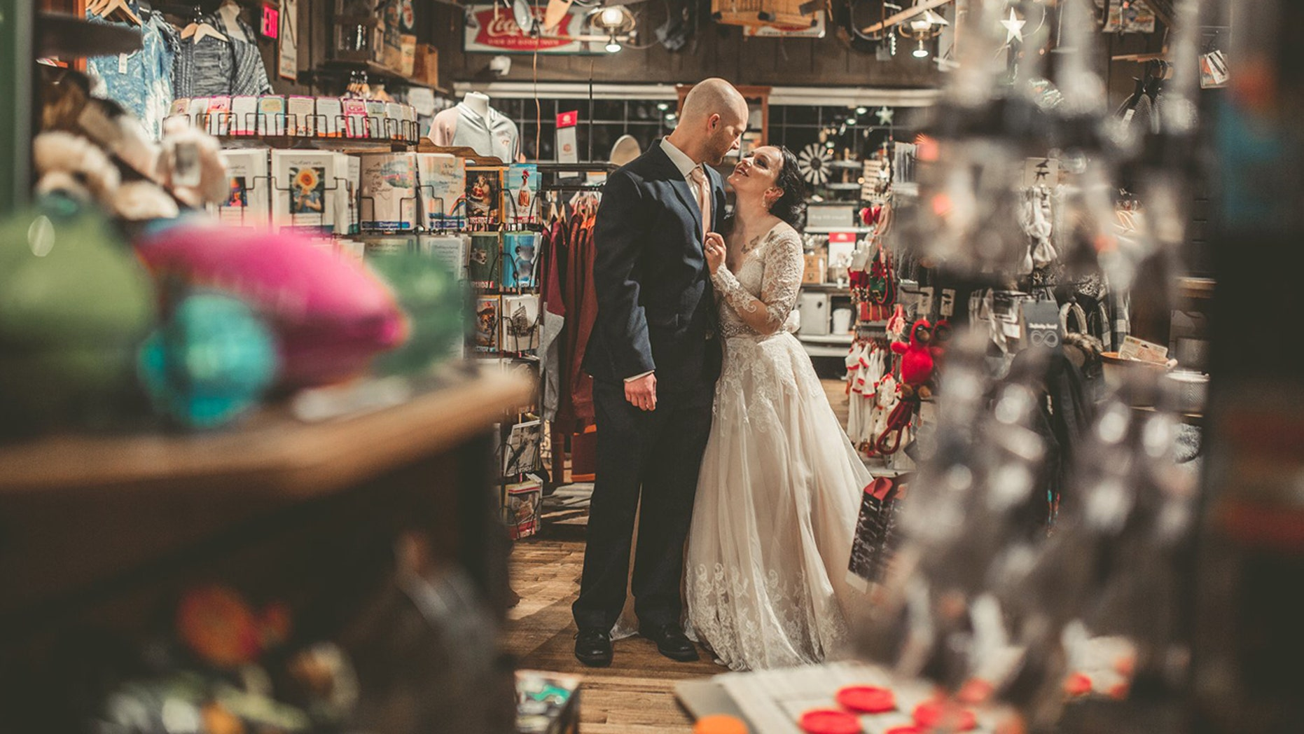 A couple who met while working at Cracker Barrel took photos on their special day at the chain.