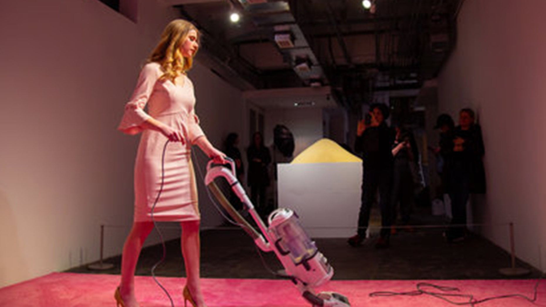 An Ivanka Trump look-alike vacuums at a recently launched art exhibit in Washington, D.C.