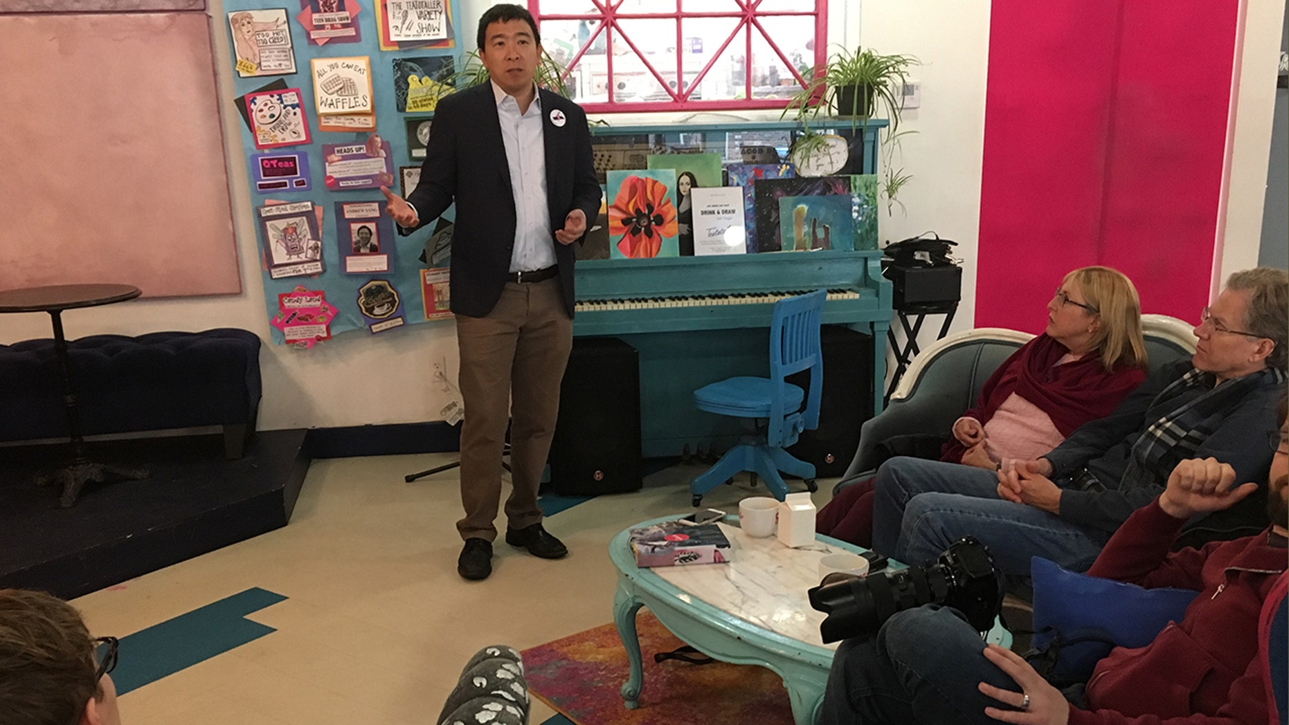 Andrew Yang talks to voters at a café in Somersworth, New Hampshire.